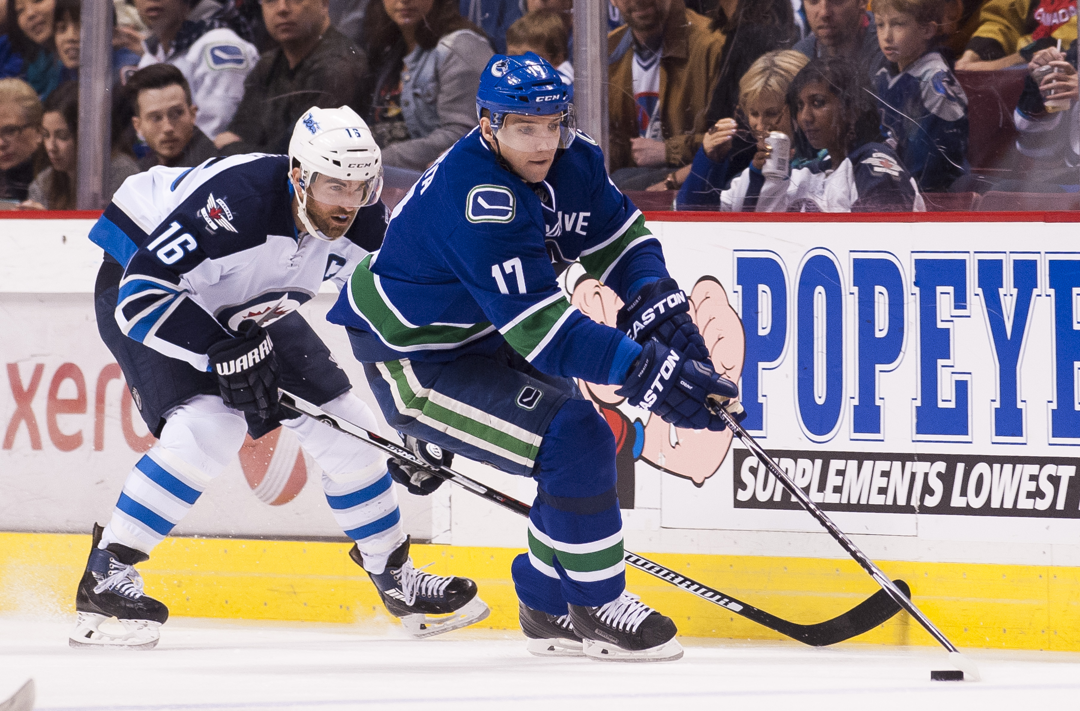 VANCOUVER, BC - MARCH 24: Andrew Ladd #16 of the Winnipeg Jets tries to check Radim Vrbata #17 of the Vancouver Canucks off the puck in NHL action on March, 24, 2015 at Rogers Arena in Vancouver, British Columbia, Canada.