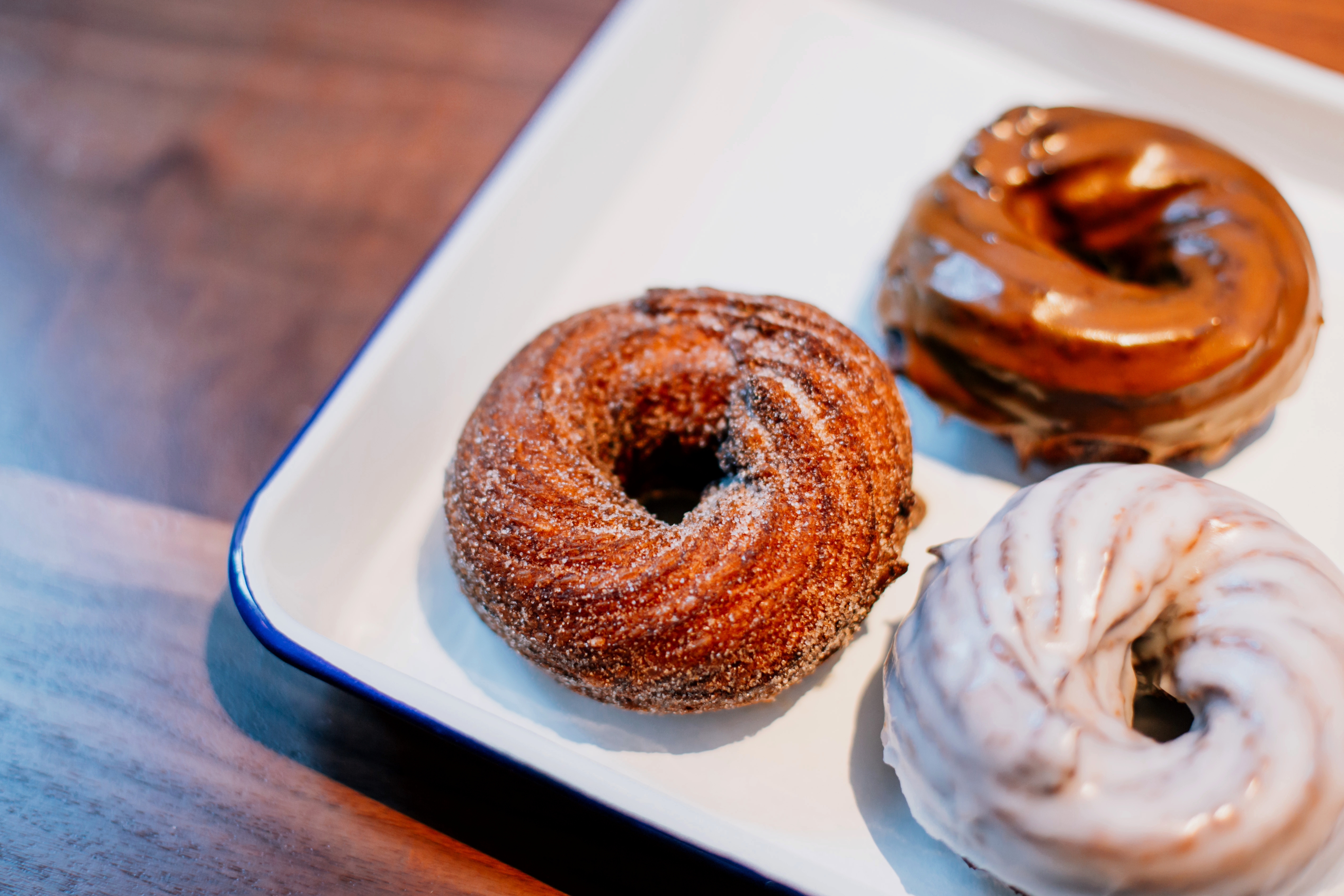 Cinnamon sugar, maple, and glazed crullers at Daily Provisions