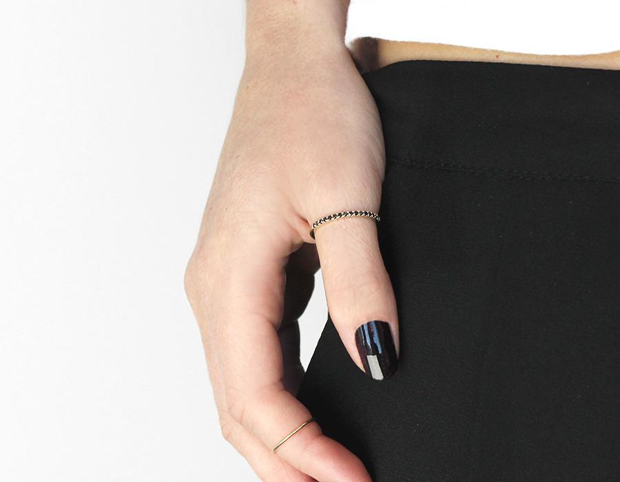 "Vrai & Oro Petite Black Diamond Band, <a href=""http://vraiandoro.com/products/petite-black-diamond-band#.VsOHmvGljeR"" target=""_blank"">$375</a>"