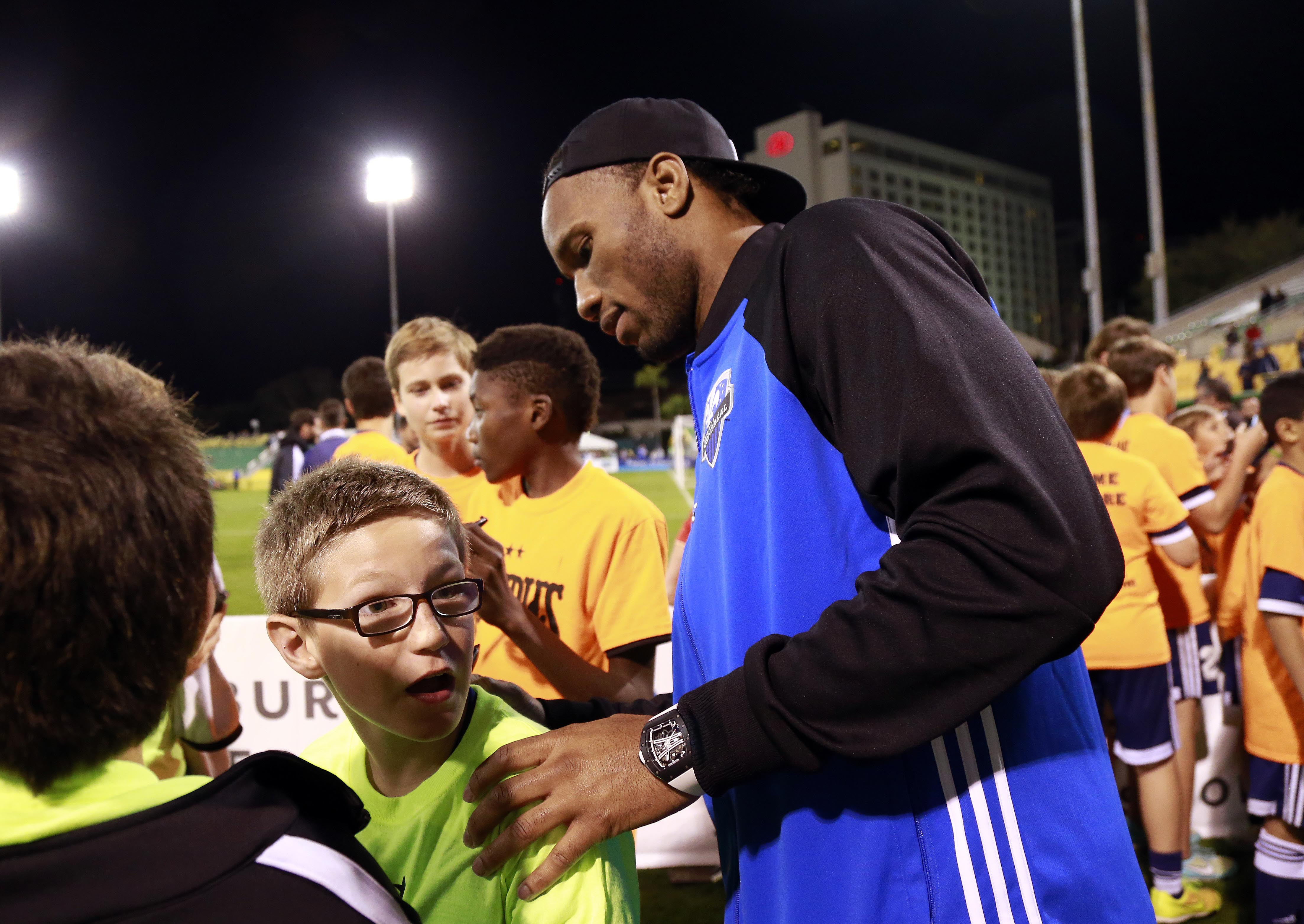 Montreal Impact forward Didier Drogba signs autographs after the game against New York City FC at Al Lang Stadium.
