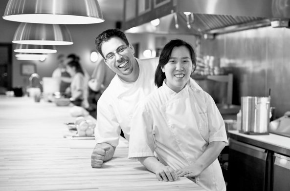 A black-and-white photo of Seif Chirchi (left) and Rachel Yang (left) at Joule