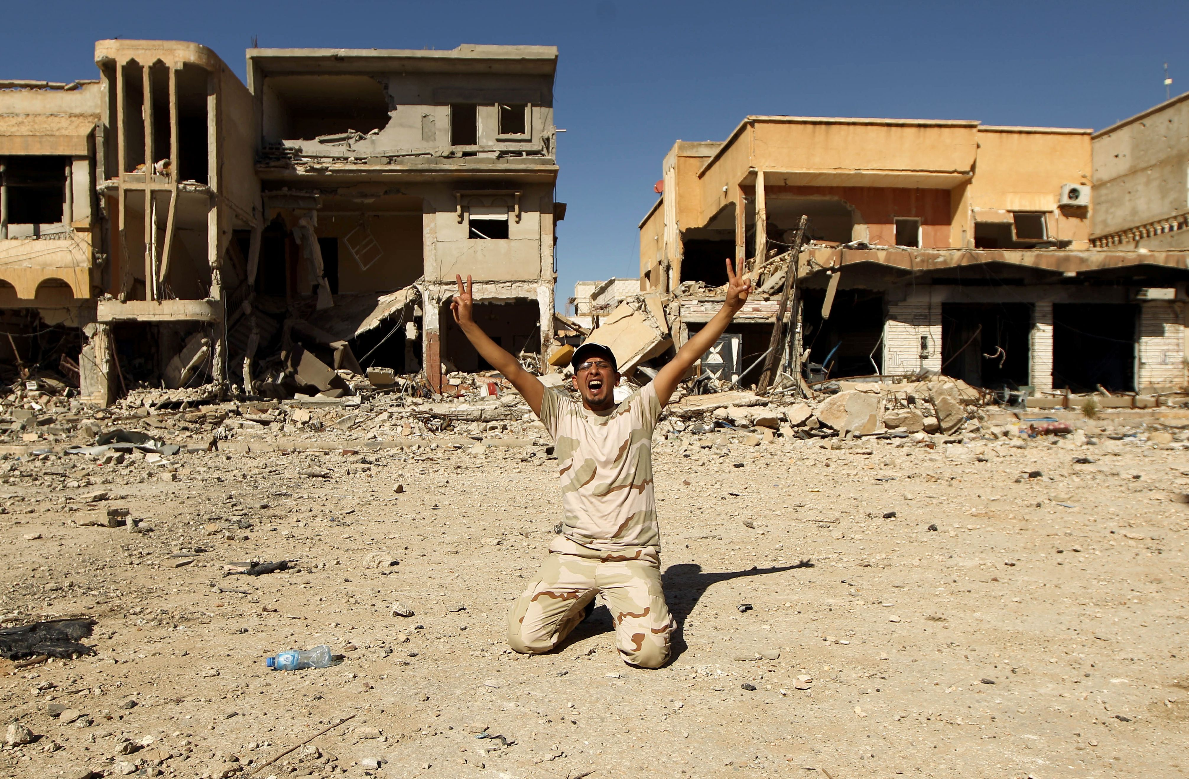 A pro-government fighter in Benghazi celebrates victory.
