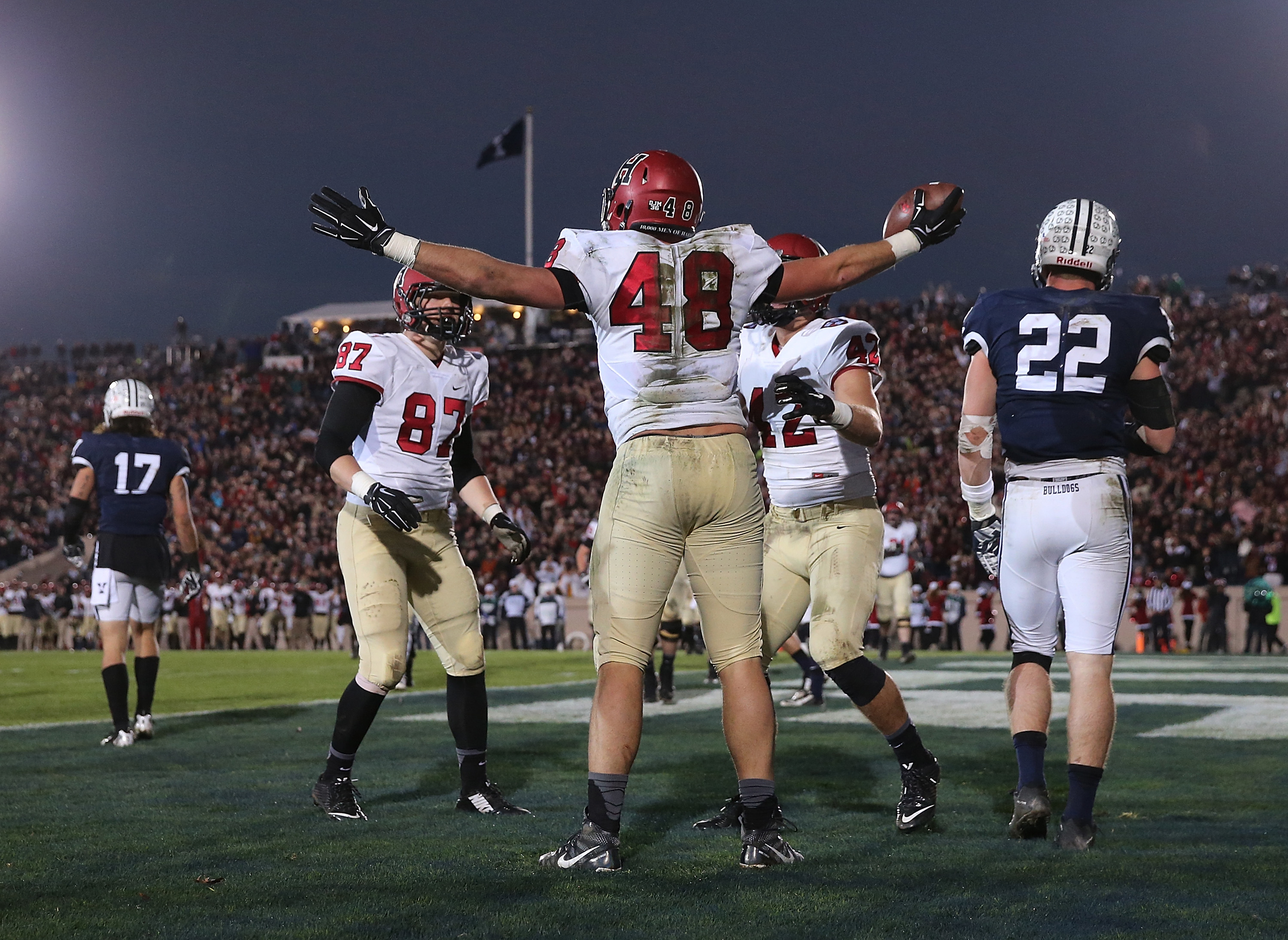 Ben Braunecker (48) celebrates after catching a touchdown against Yale.