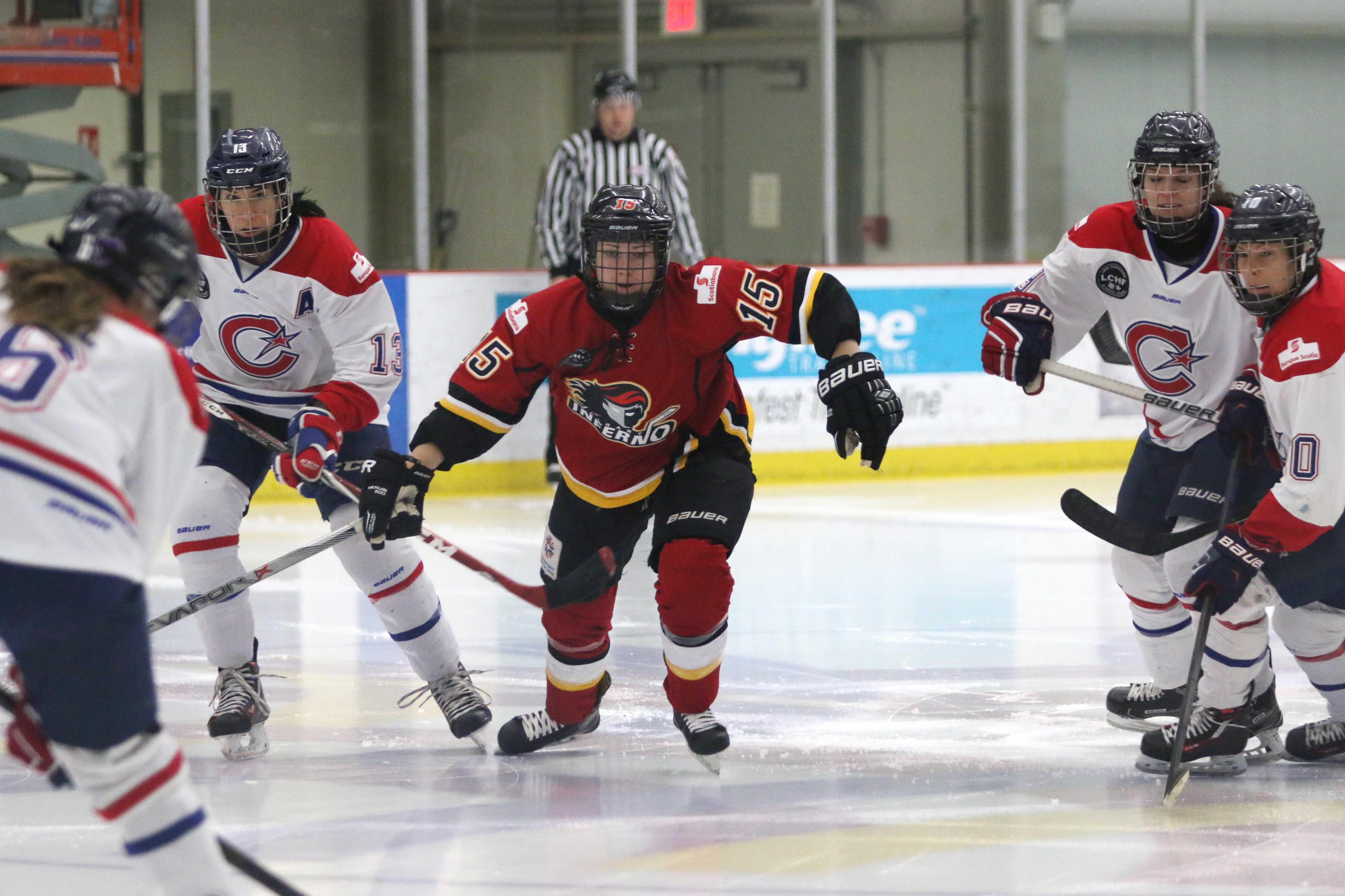 Elana Lovell (center) is up for Rookie of the Year after being a point-per-game player in the regular season for the Inferno.