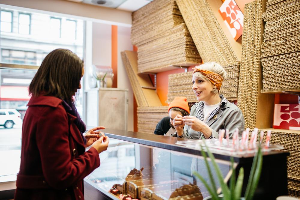 Alexandra Clark of Bon Bon Bon talks with a customer at her retail shop on Griswold Street.
