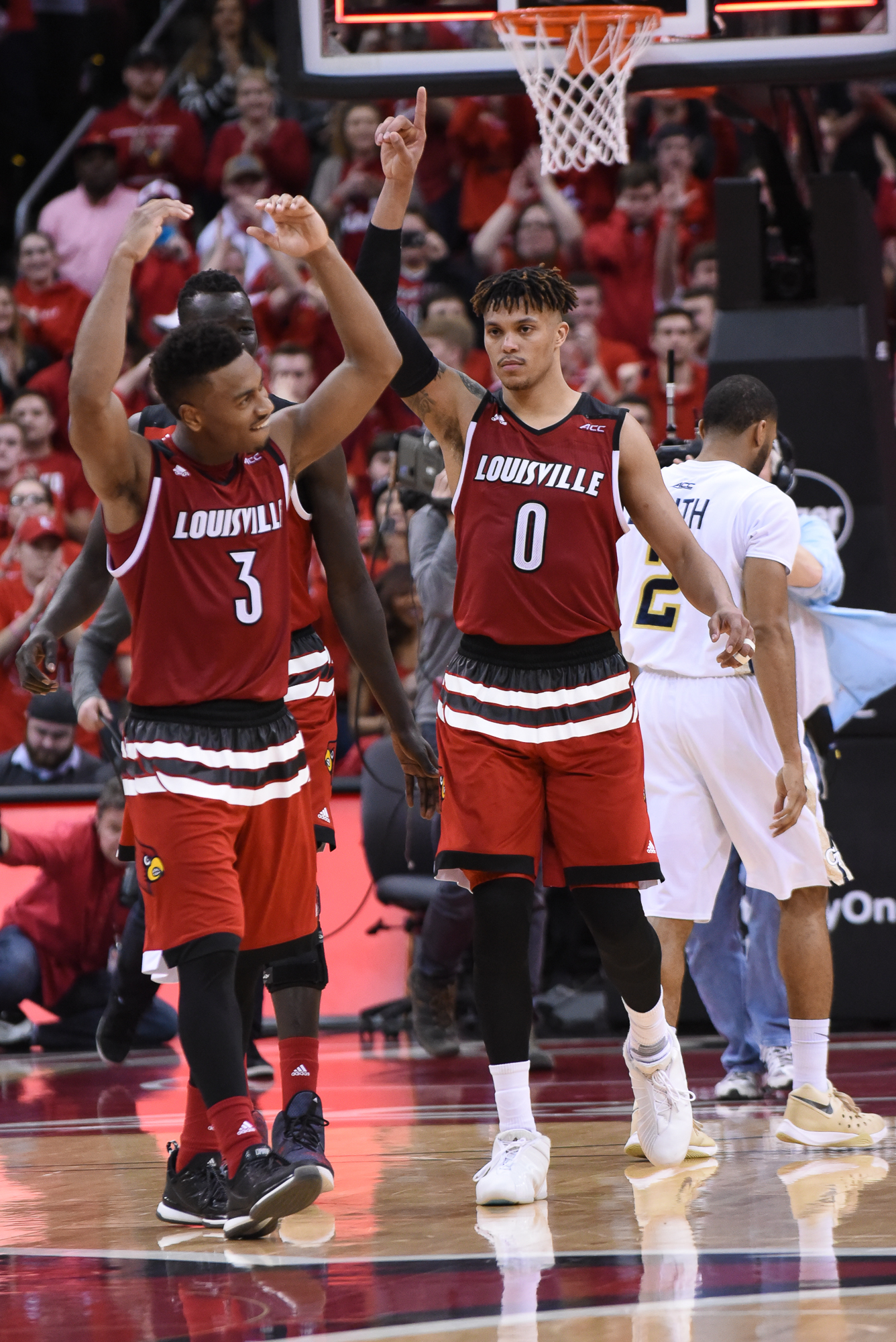 Lewis and Lee celebrate the win over Georgia Tech