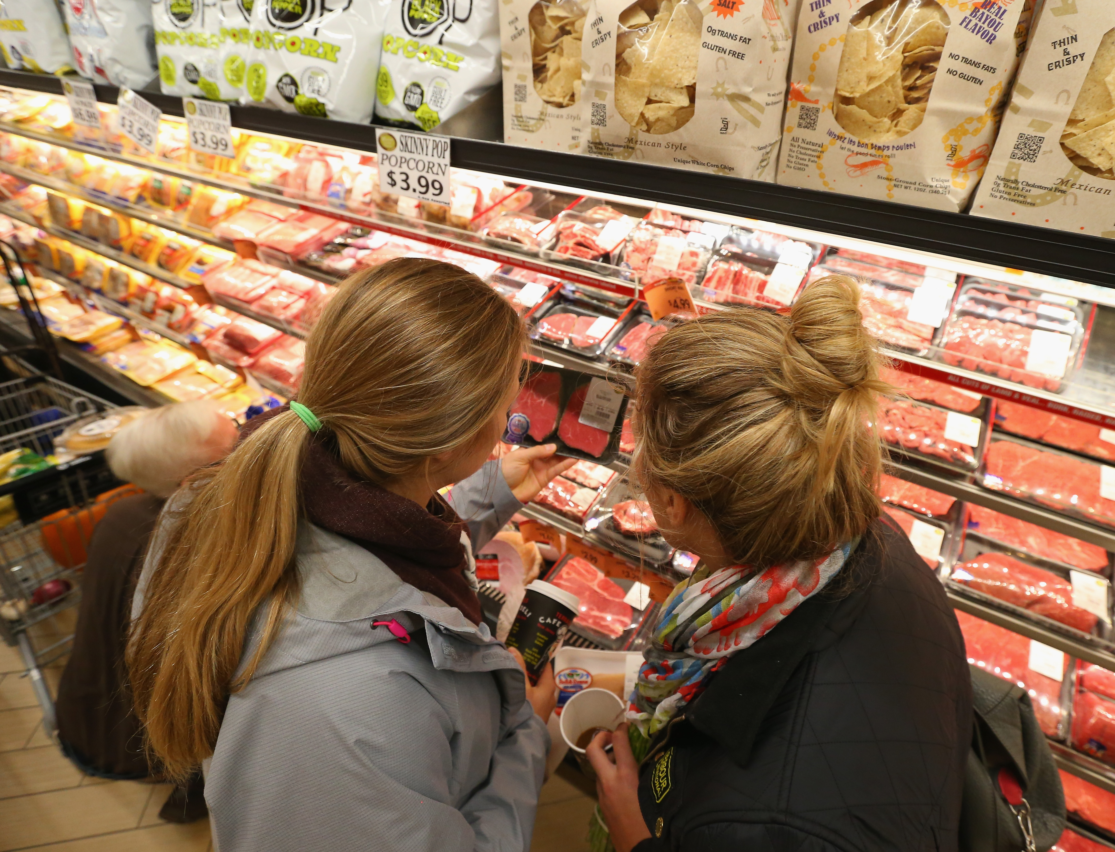 Yes, this is Kiira Dosdall and Janine Weber buying meat at a grocery store.