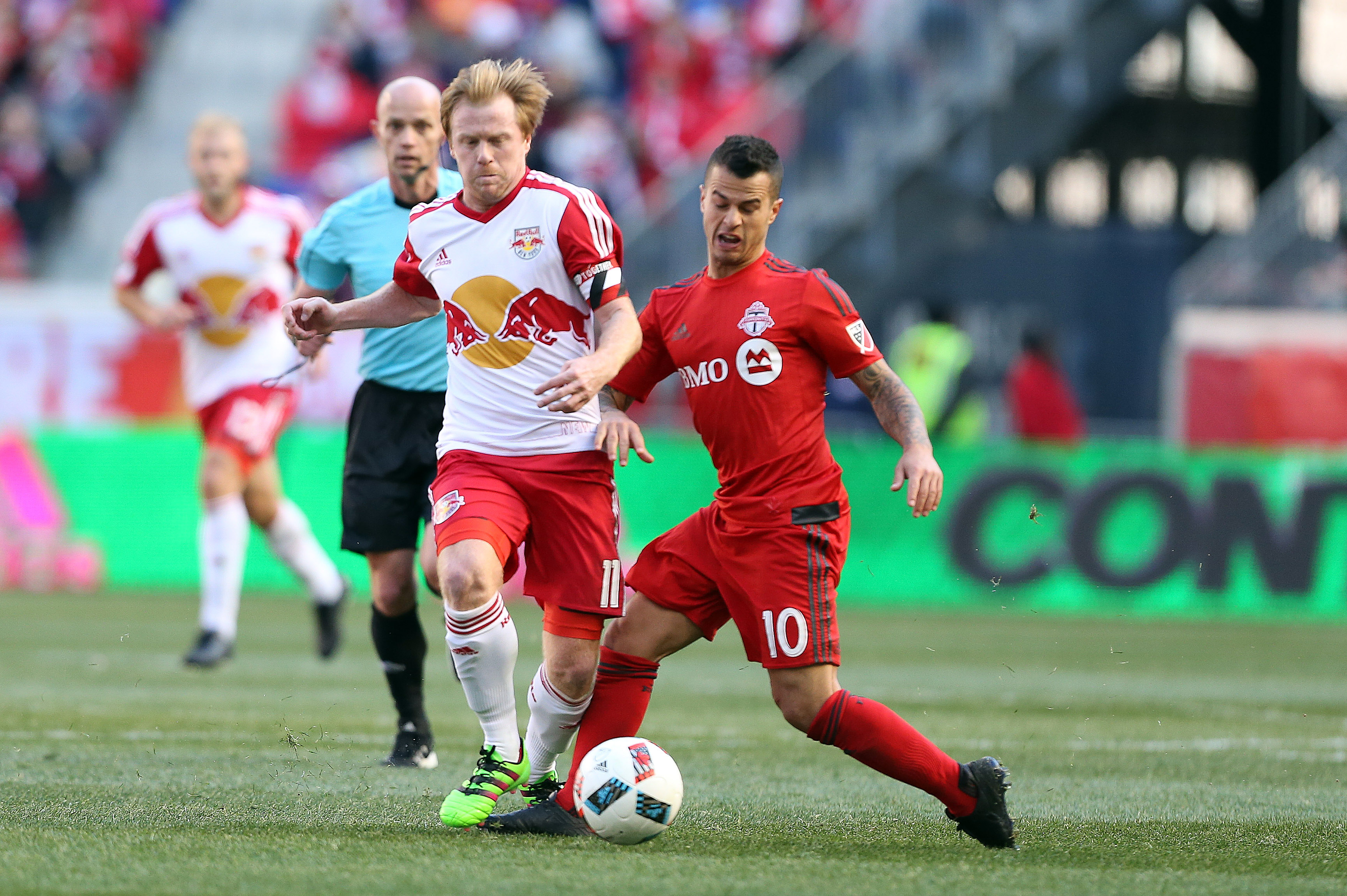 Dax McCarty (left) fighting for a loose ball with Sebastian Giovinco in the Red Bulls' 2-0 loss to Toronto FC on March 6th at Red Bull Arena.