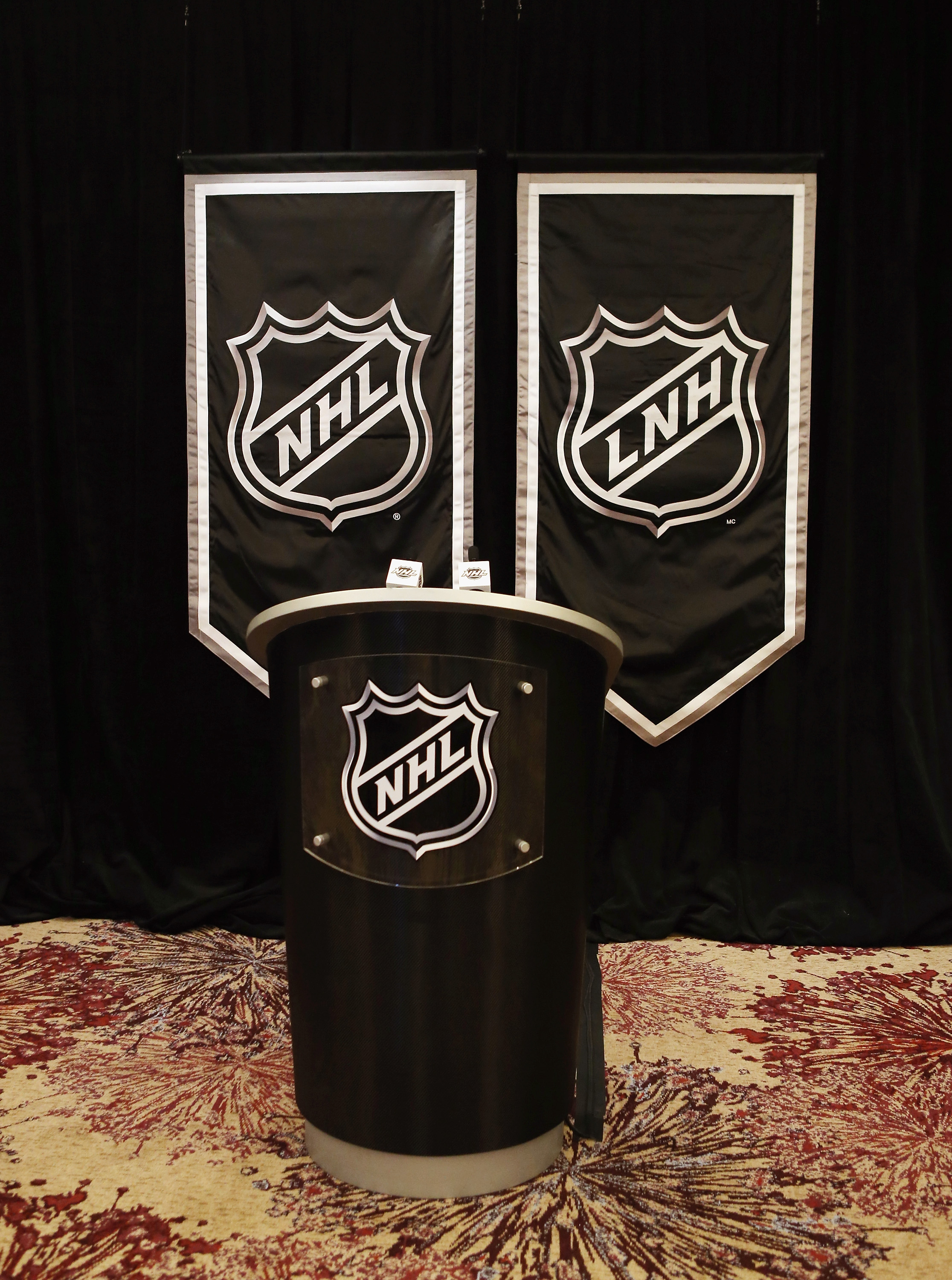 Lacking an idea of what photo to use for this social media inspired article, we'll just use the NHL logo and podium.