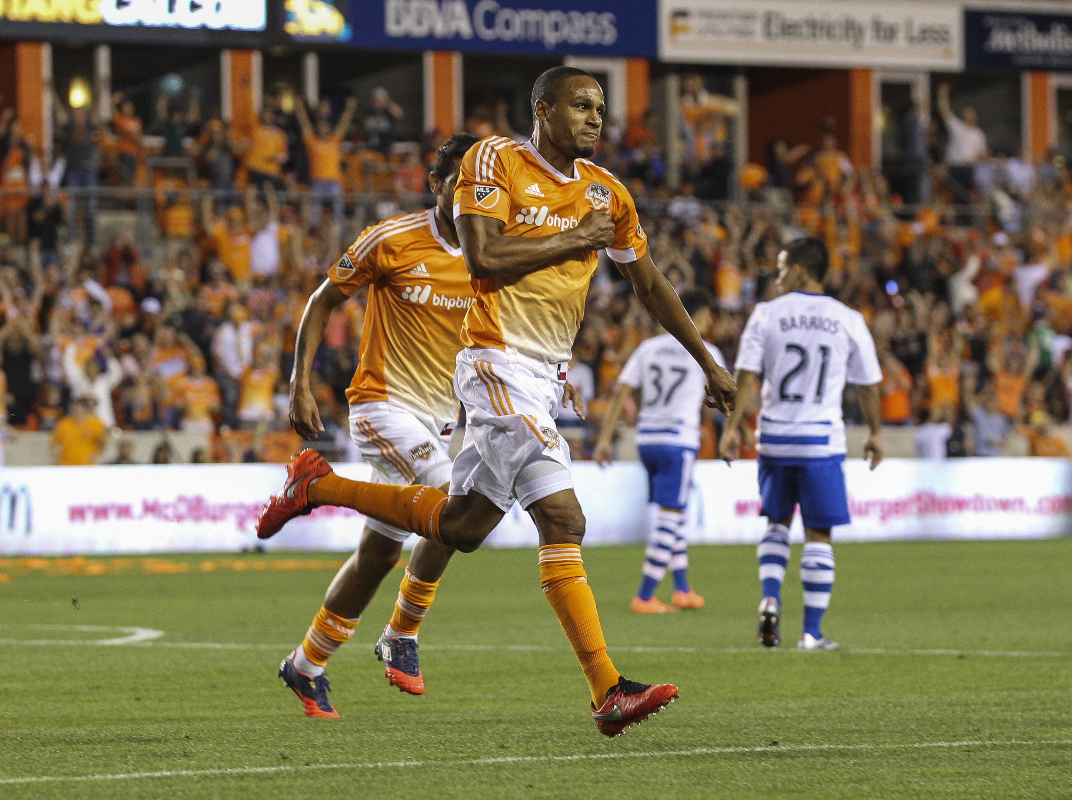 Ricardo Clark celebrates his goal while Michael Barrios (21) and Maxi Urruti (37) sulk in the background. Both were partially at fault.
