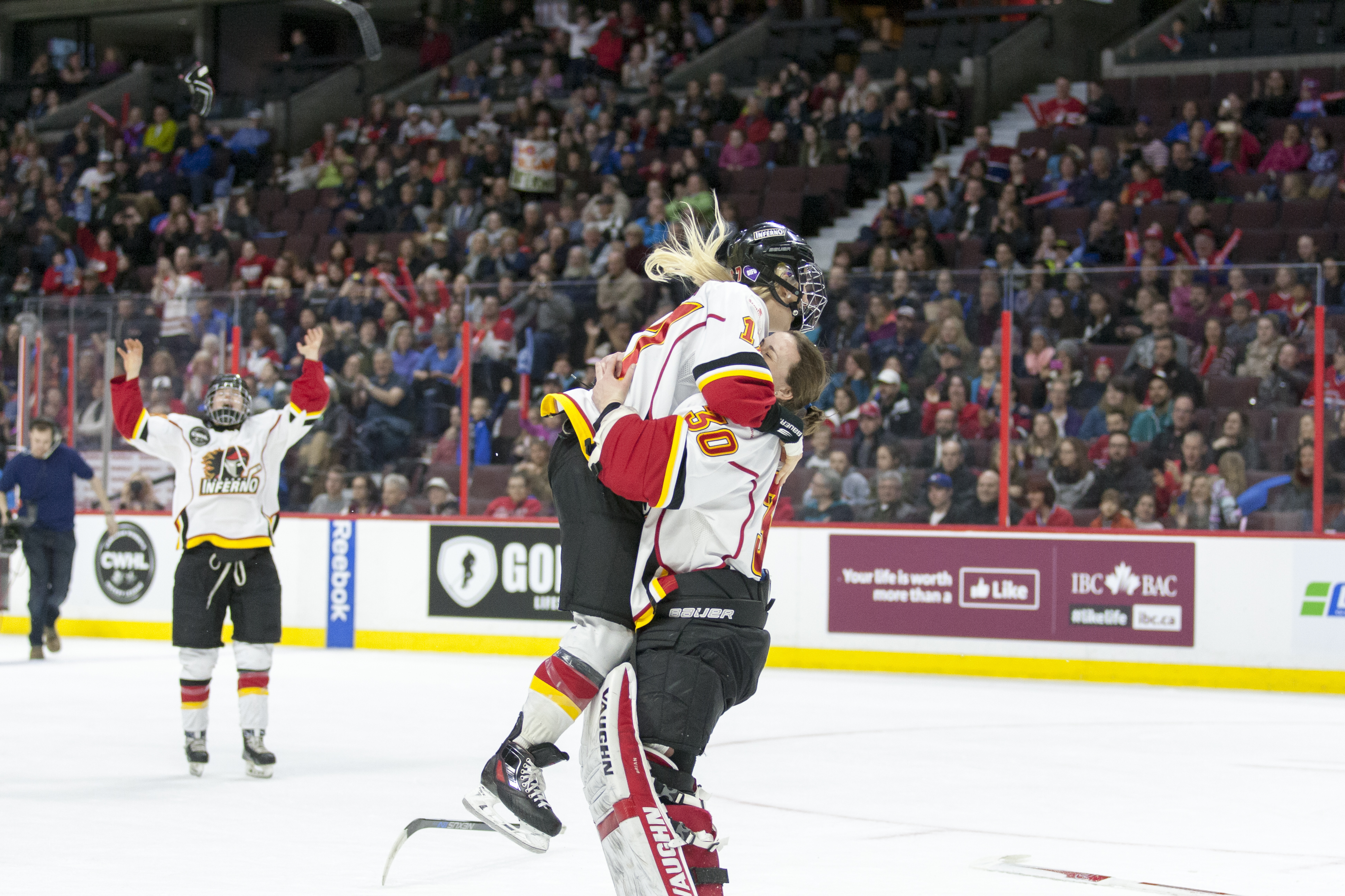 Bailey Bram and Delayne Brian celebrate after winning the first Clarkson Cup in the Calgary Inferno's five-year history. Brian made 38 saves and earned both First Star of the Game and MVP of the series for her performance in net.