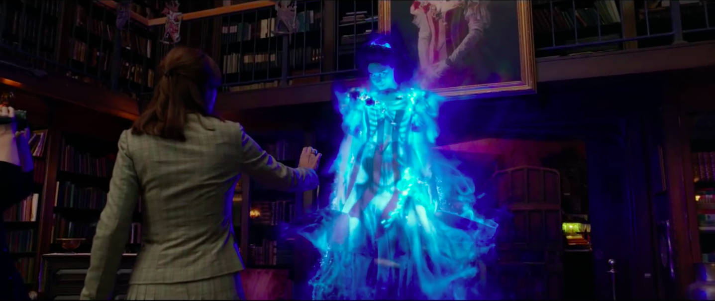 A finely-attired ghost approaches Kristen Wiig in the new Ghostbusters.