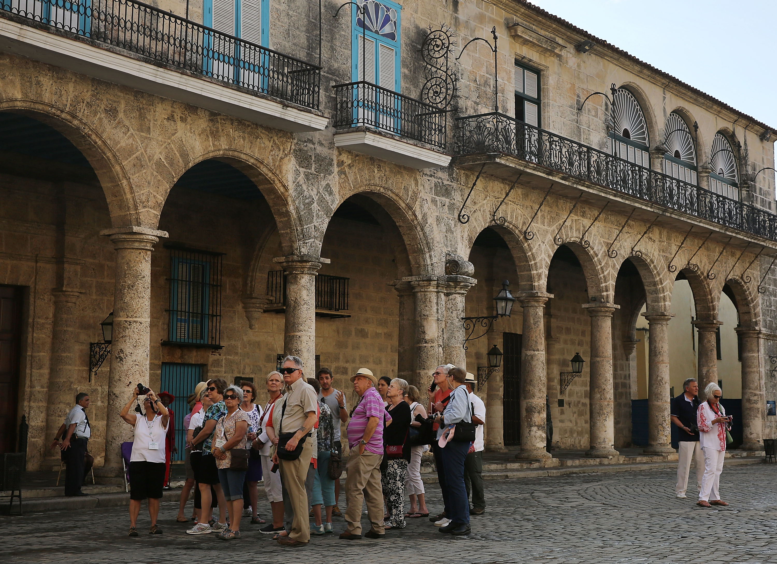 : Tourists take in the sites at Cathedral Square in Old Havana as Cuba prepares for the visit of US President Barack Obama on March 19, 2016, in Havana, Cuba.