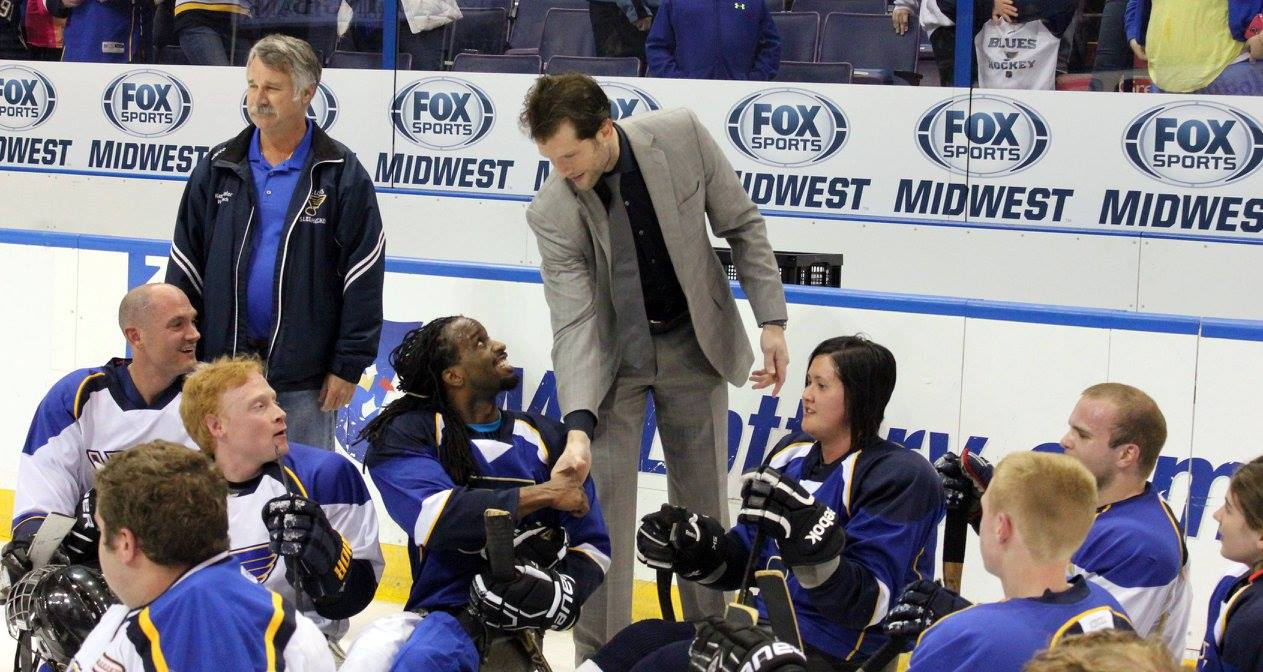 Blues captain David Backes greets athletes from the DASA Blues after a scrimmage at Scottrade Center