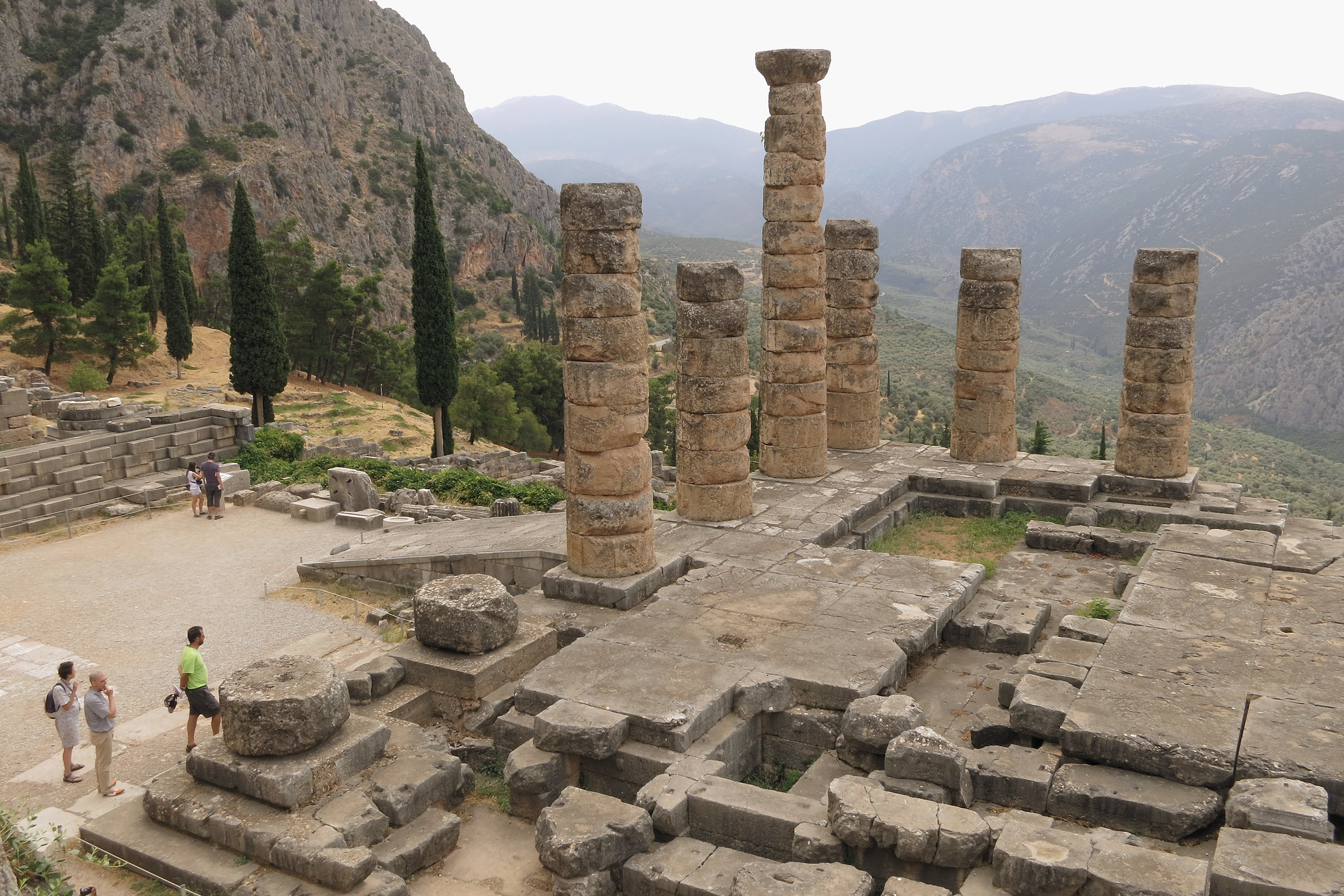 Visitors look at the former Palace of Apollo, where the oracle once prophesized the future, at the ancient archeological site of Delphi