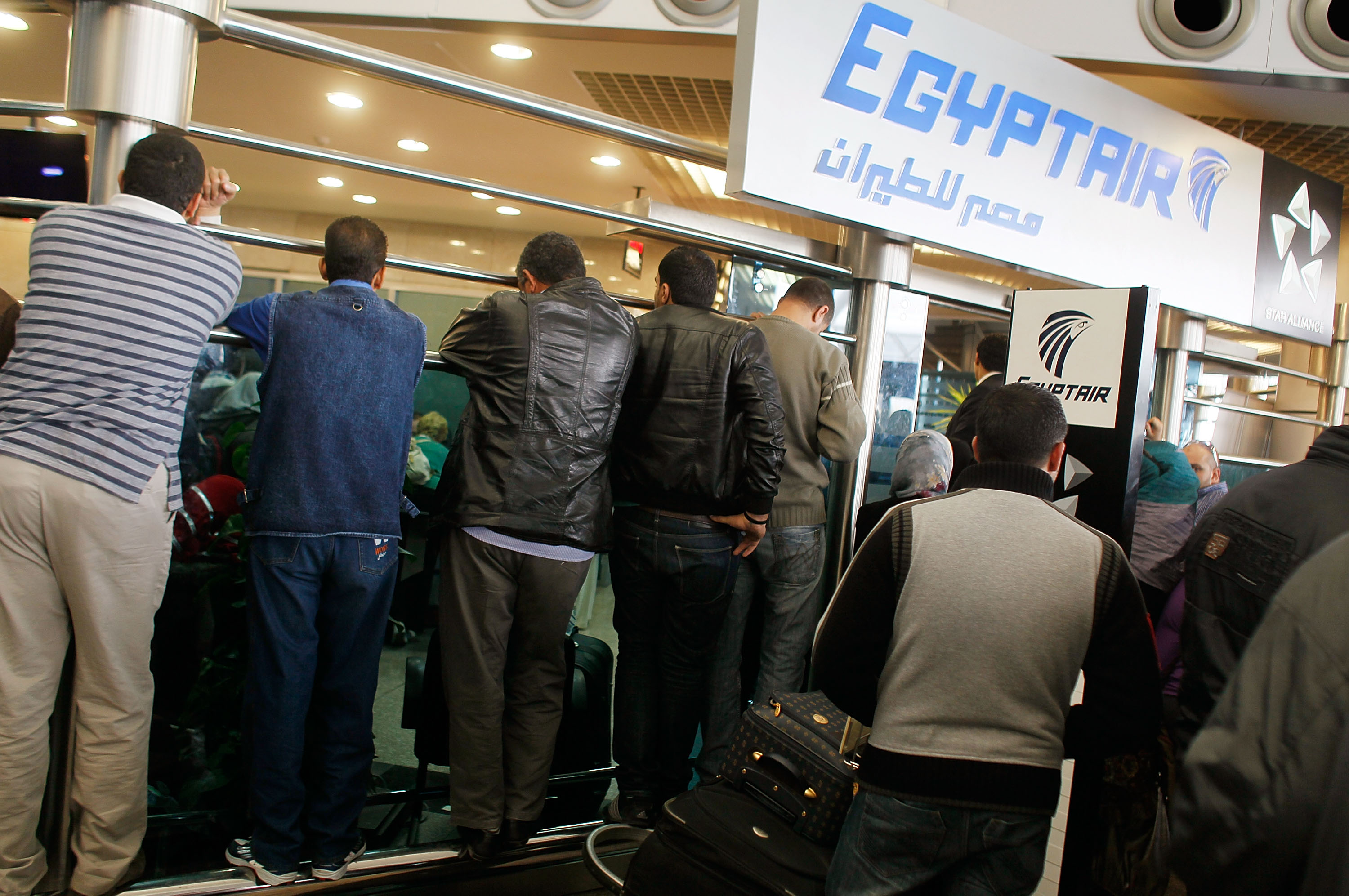 A crowd of people wait at an EgyptAir check-in counter at Cairo International Airport on January 31, 2011, in Cairo, Egypt.