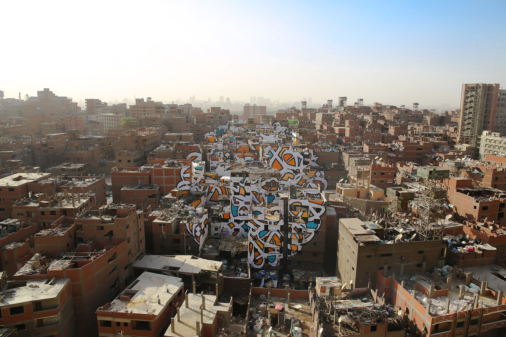 A new mural in Cairo covers more than 40 buildings. The result is stunning.