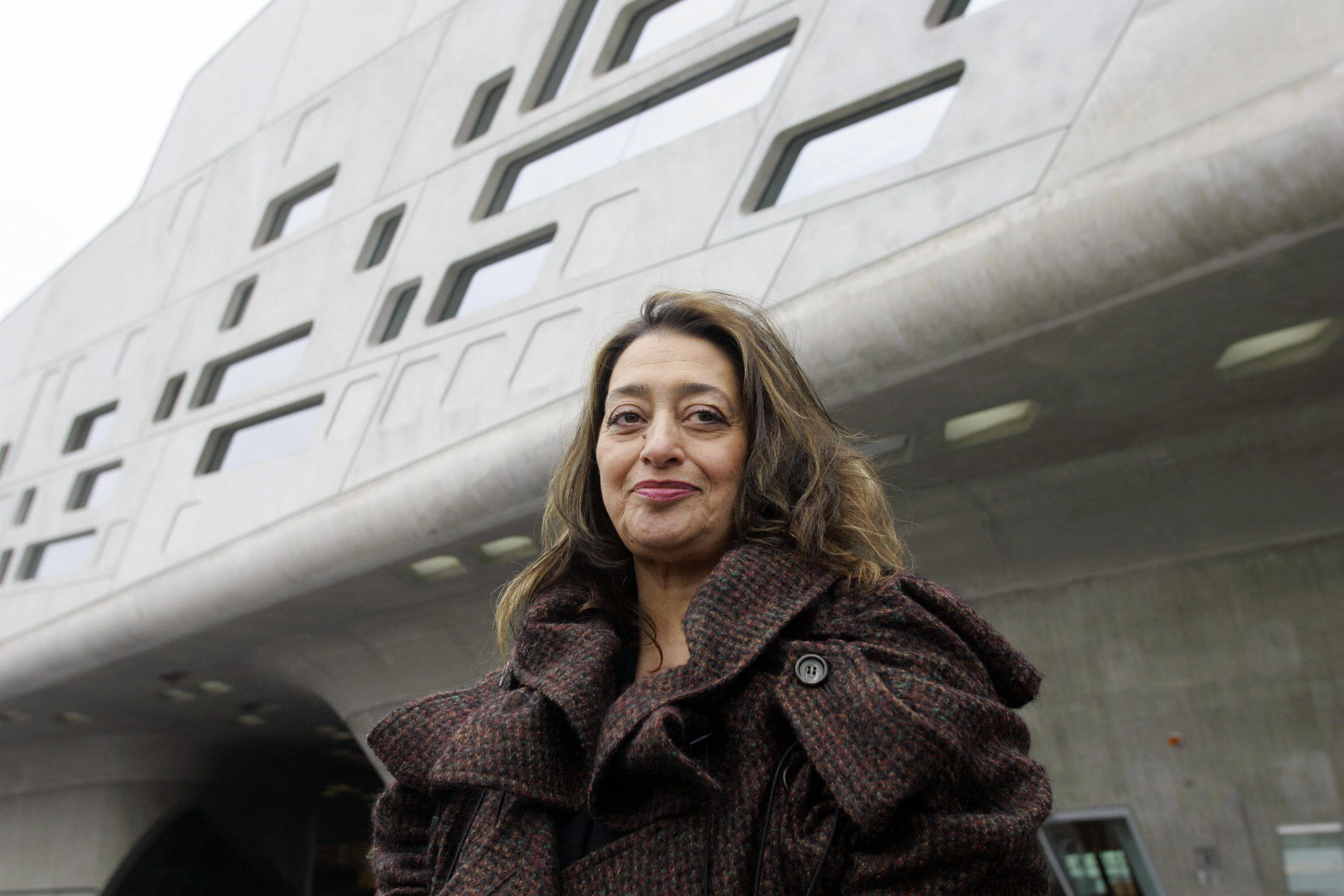 Zaha Hadid poses in front of the Phaeno Science Center in Wolfsburg, Germany, which she designed, in 2005.
