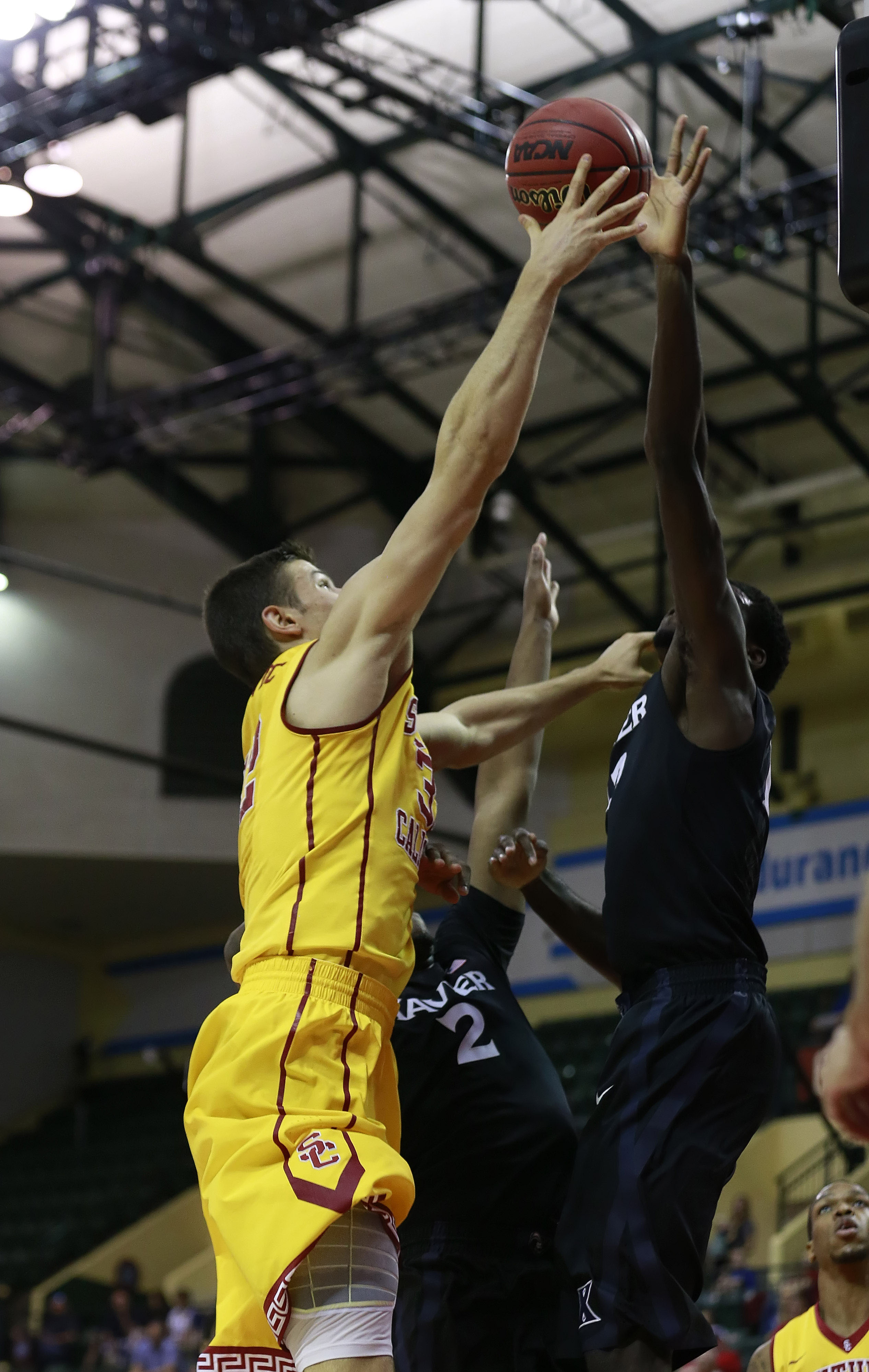 If Makinde is coming from the help side, you're better off holding onto the ball and taking the travel.