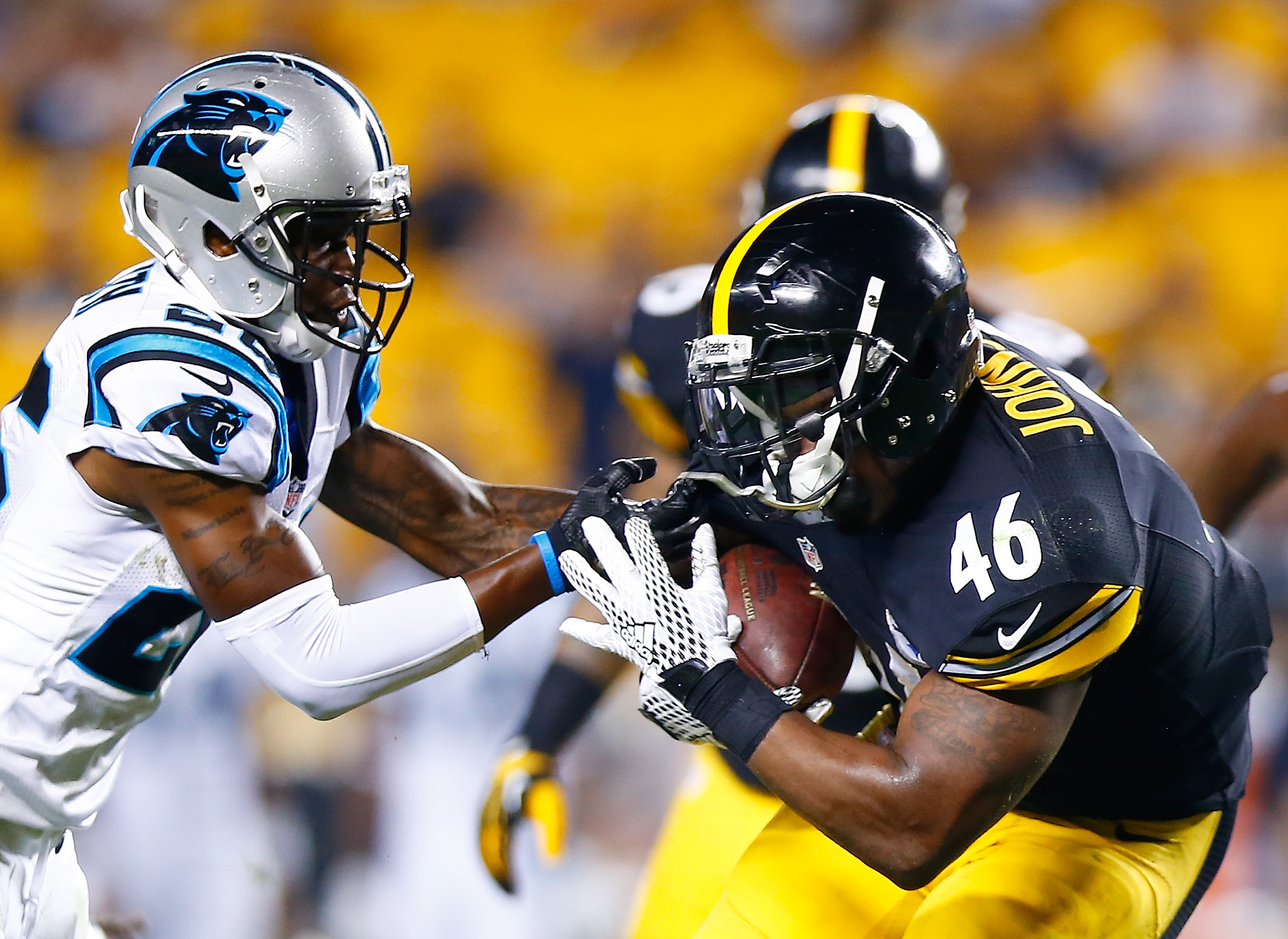 Will Johnson carrying the ball with the Steelers