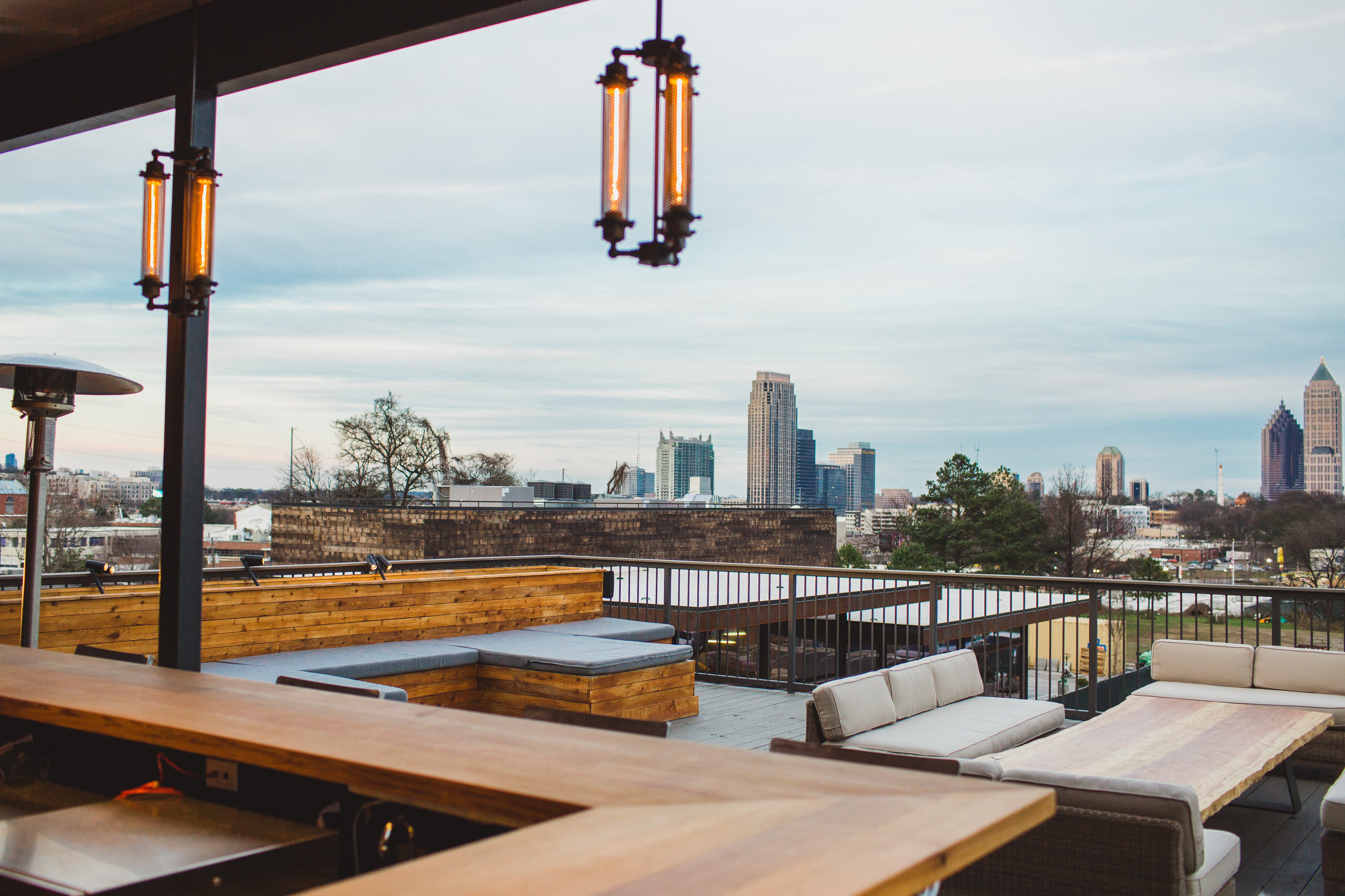 The rooftop patio at O-Ku Sushi, complete with a view of Midtown.