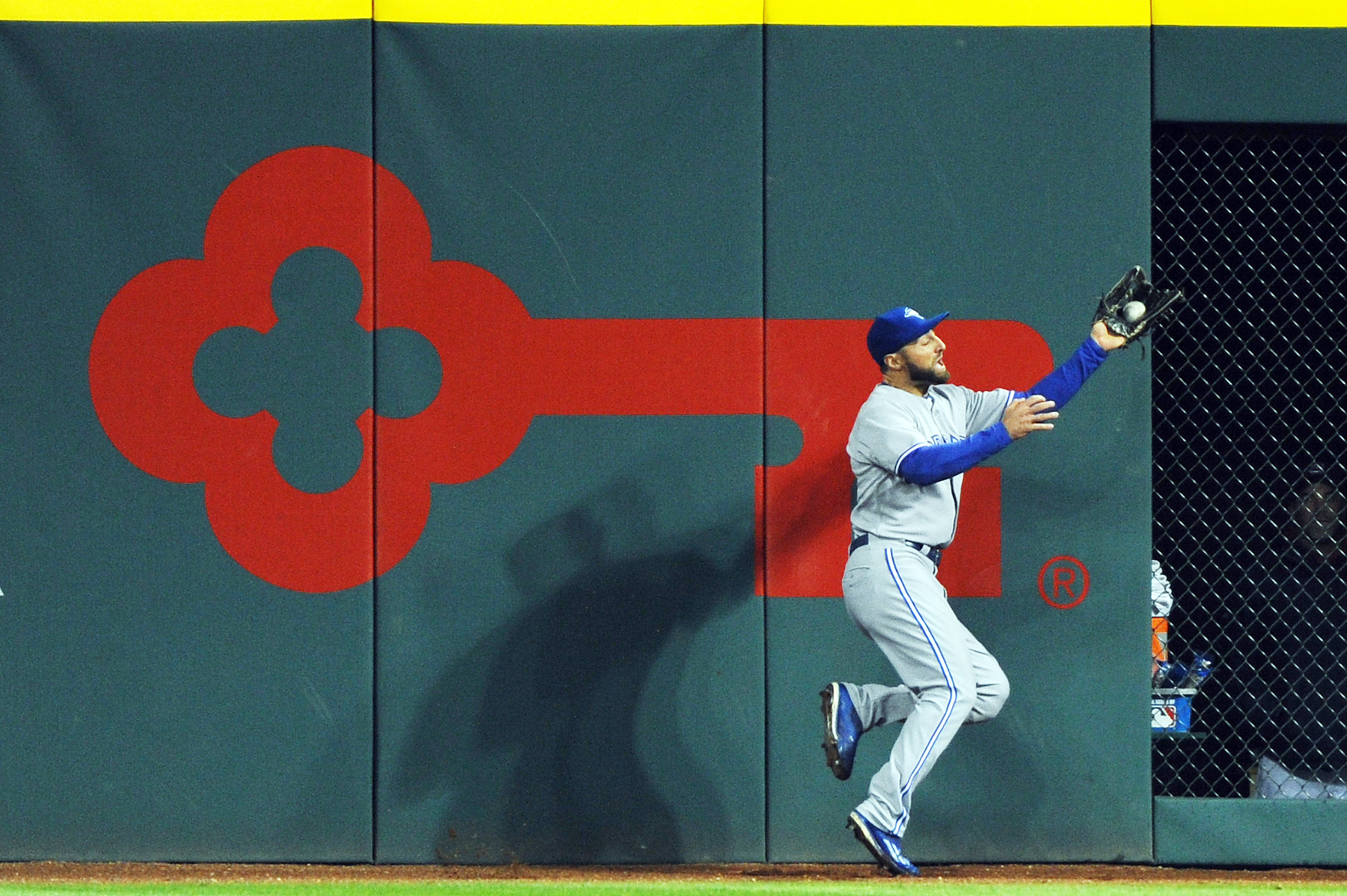 Kevin Pillar crashes into the wall making another one of his fantastic catches.