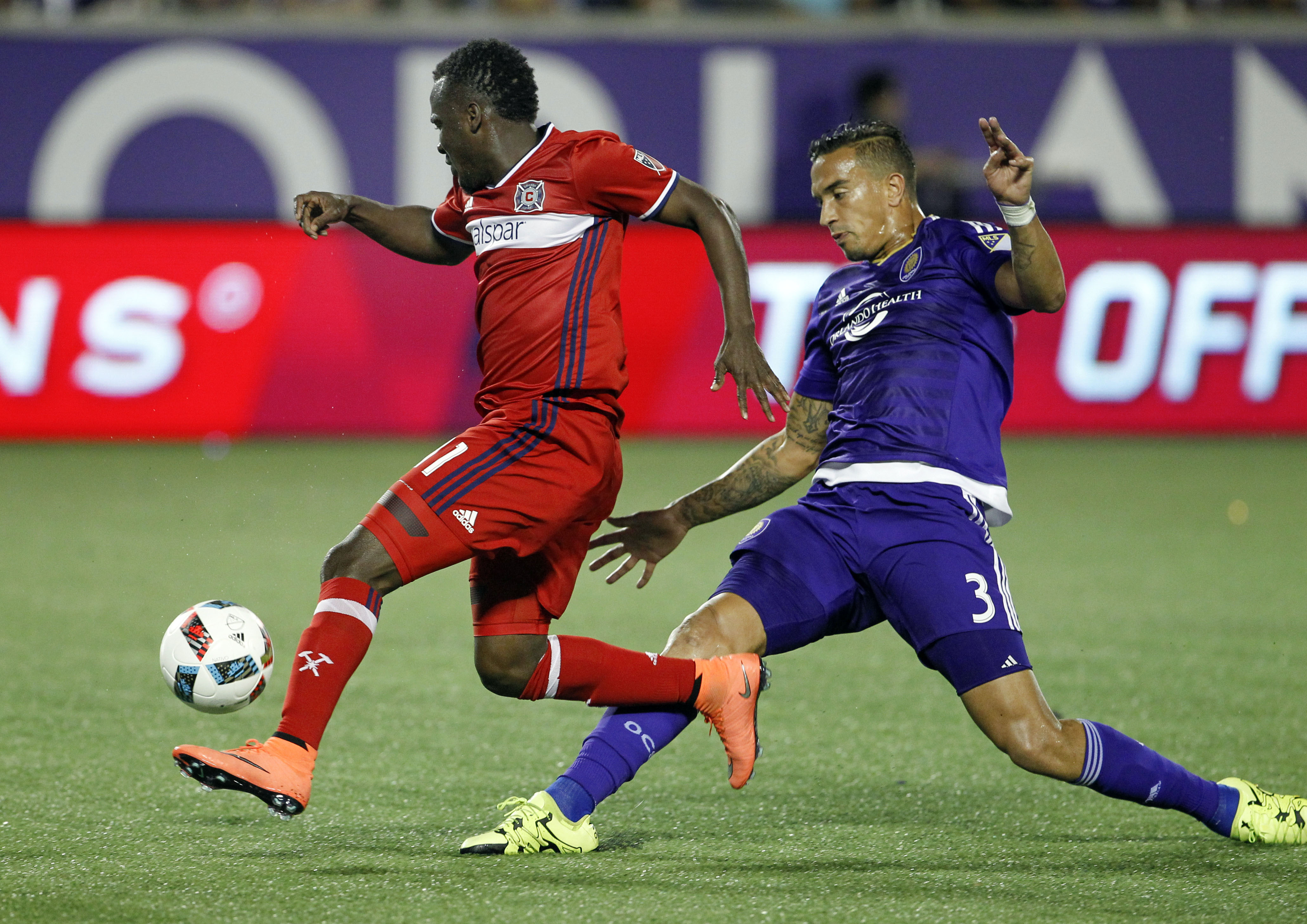 David Accam (left) beats defender Seb Hines to a loose ball before scoring in an early season game against Orlando City.