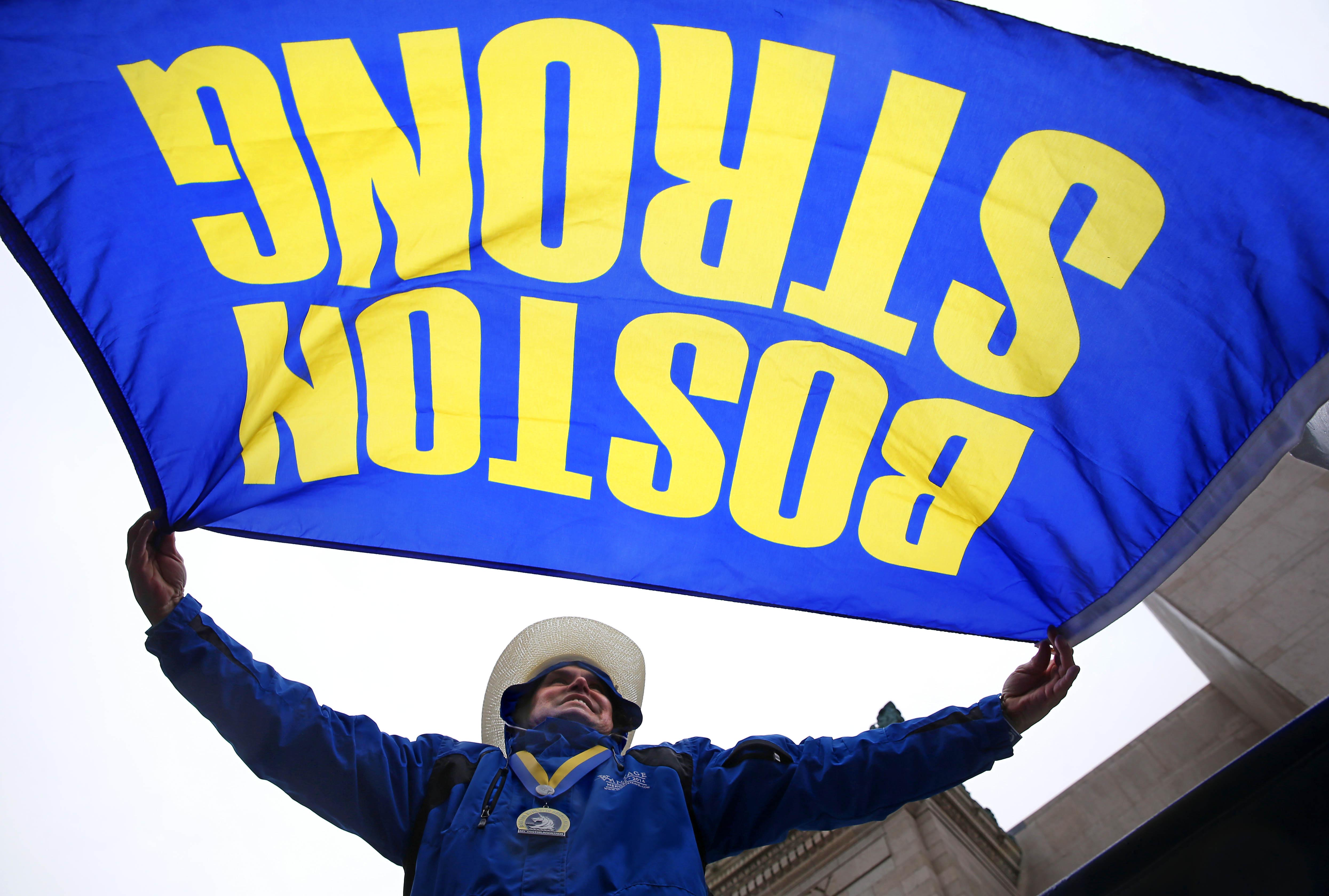 Carlos Arredondo cheers on runners in 2015. Arredondo was among the quick-thinking first-responders in the 2013 attack.