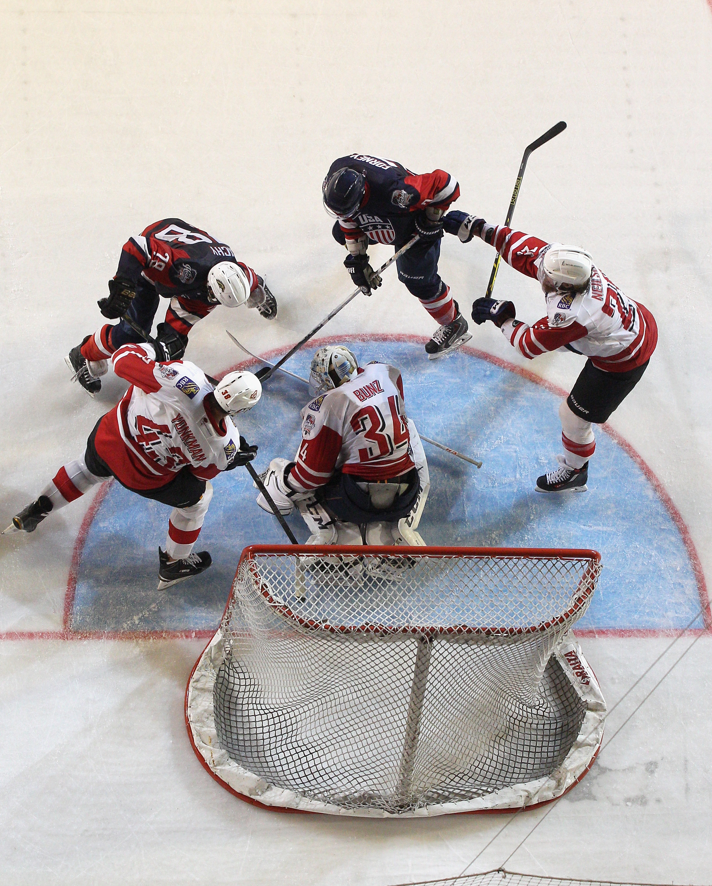 Tyler Bunz of Canada saves a shot on goal during the 2015 Ice Hockey Classic match between the United States of America and Canada at Rod Laver Arena on June 5, 2015 in Melbourne, Australia.
