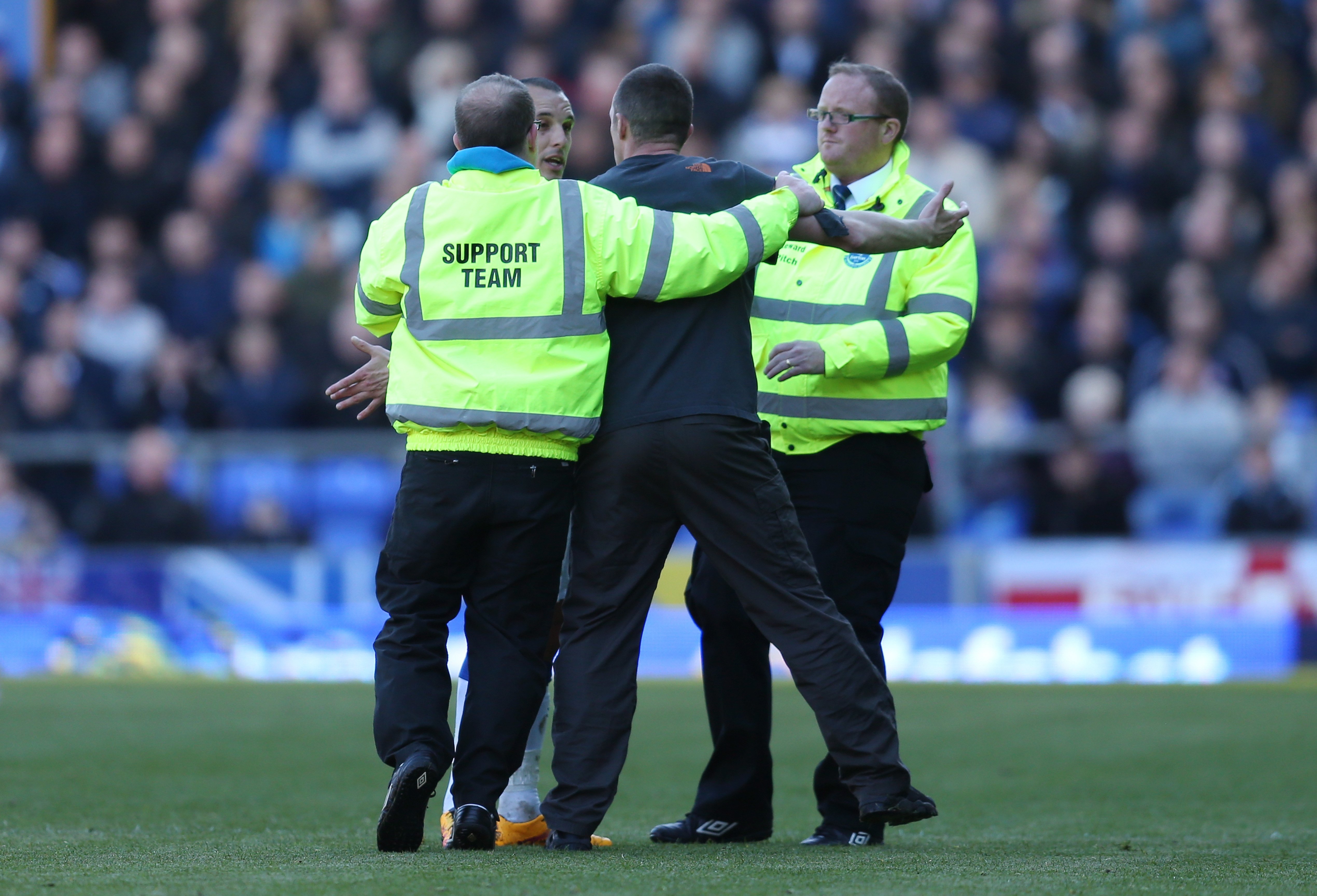 The pitch invader remonstrating with Leon Osman