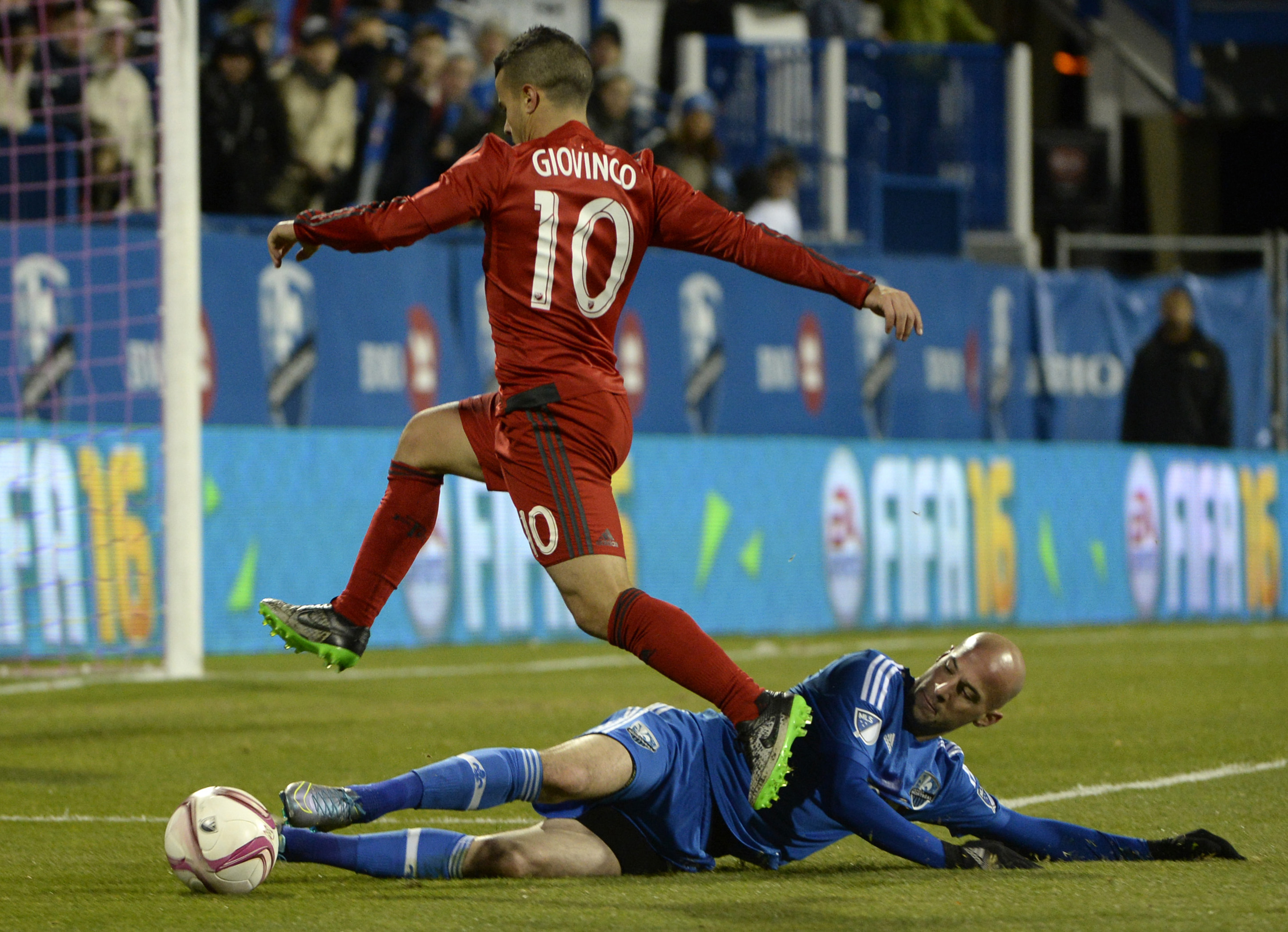 Laurent Ciman wins the ball from Sebastian Giovinco in the 2015 MLS Cup Playoffs