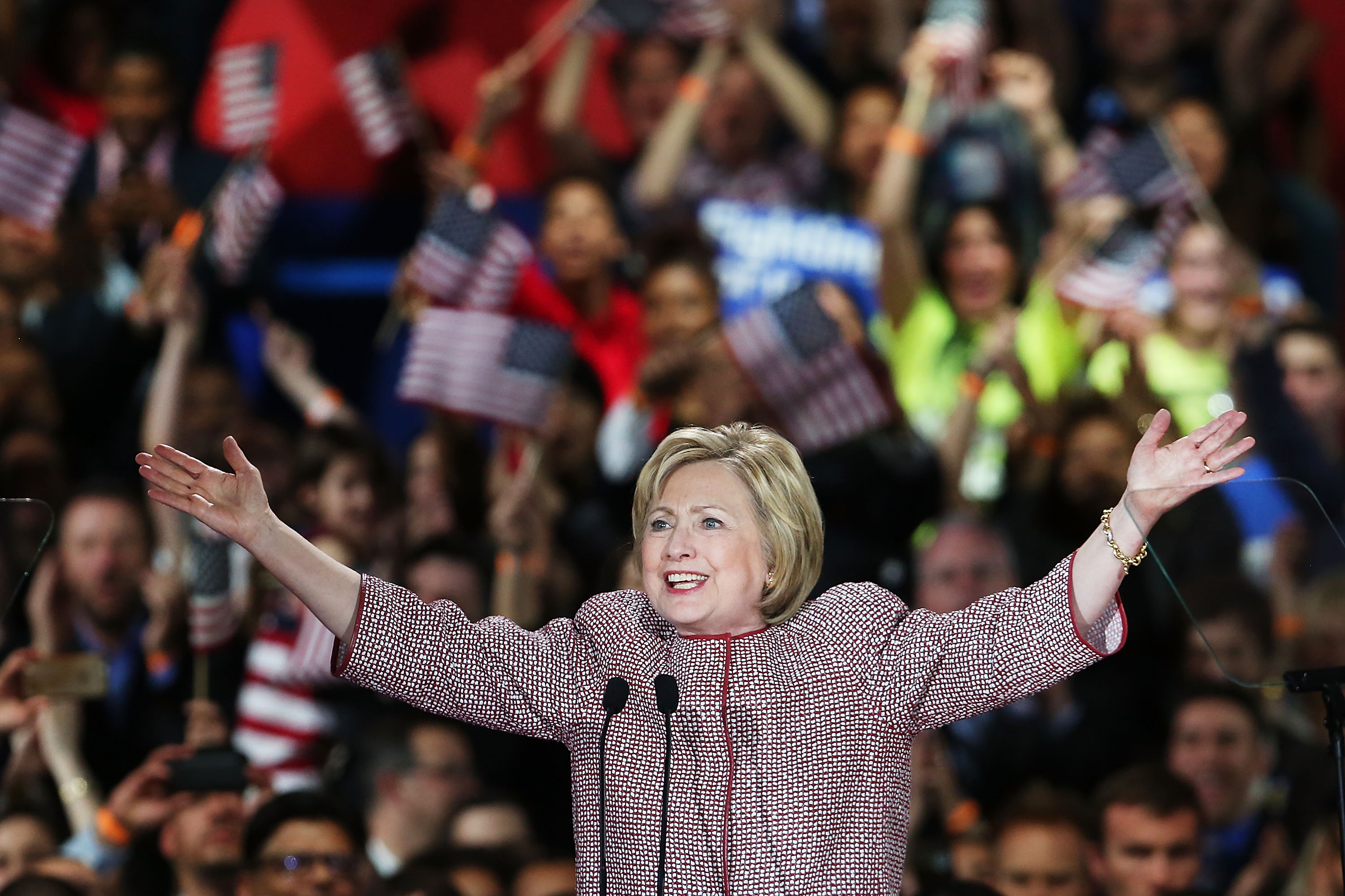 Clinton raising arms in victory