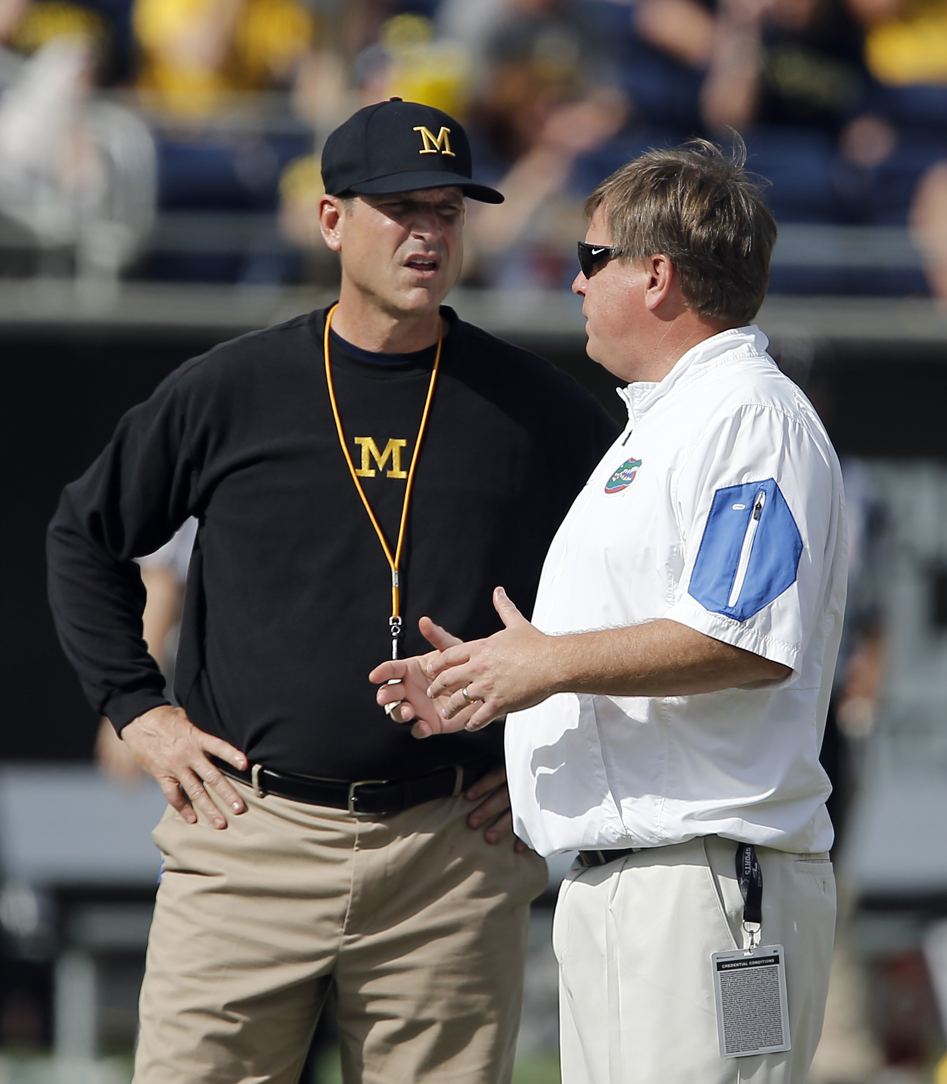 This is a picture of Jim Harbaugh and a Southern coach