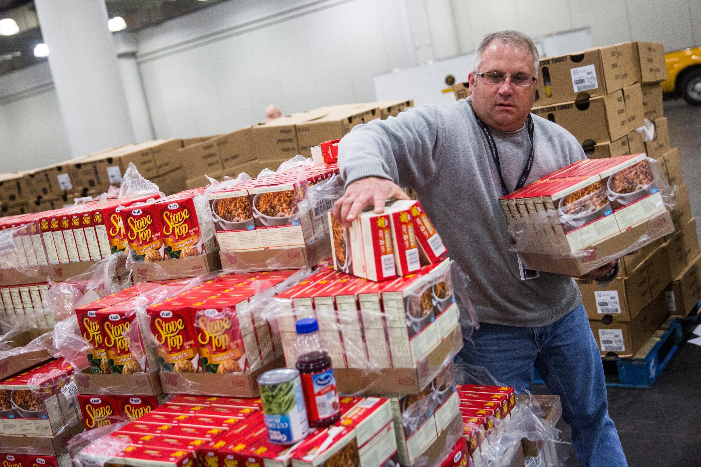 A man stocks a food bank.