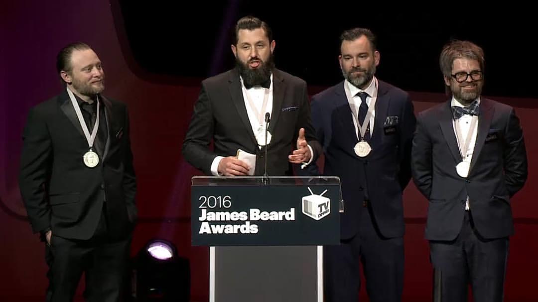 Land & Sea Dept. accepts their Beard Award.