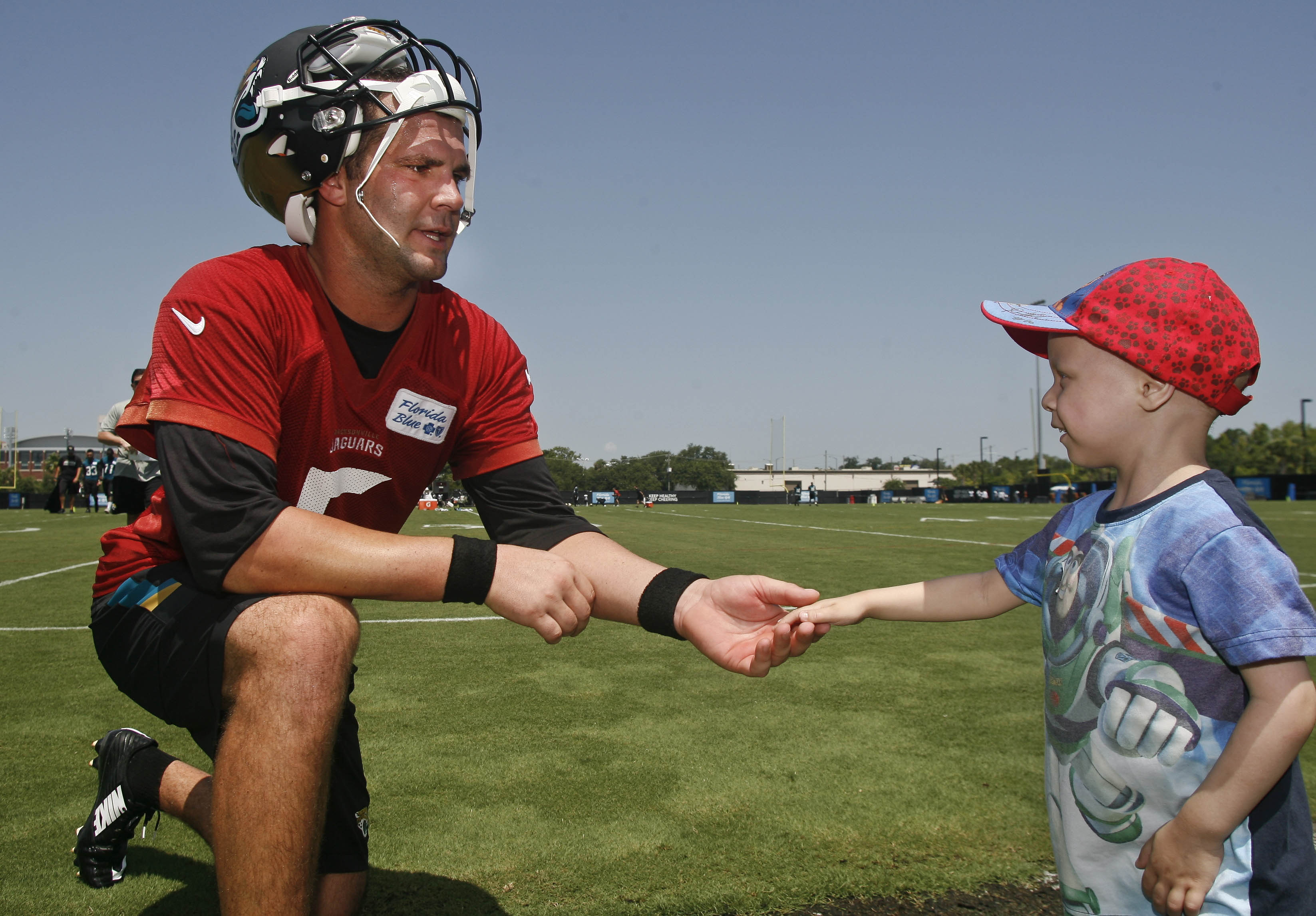 Blake Bortles consoles a young Jaguars fan, tells him it will be ok soon.