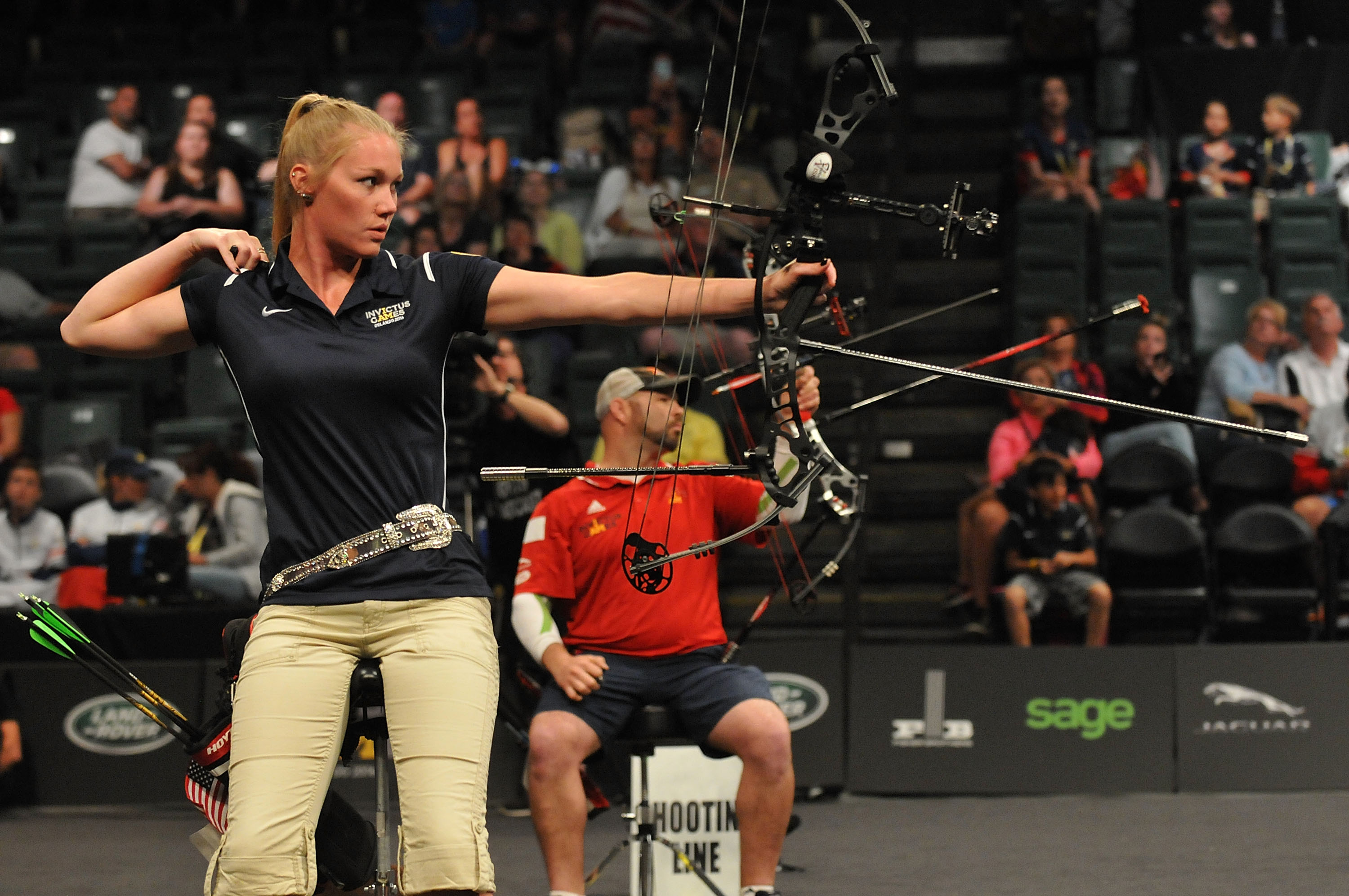 Luc Martin (CAN) and Chasity Kuczer (USA) shoot during the Archery Finals.
