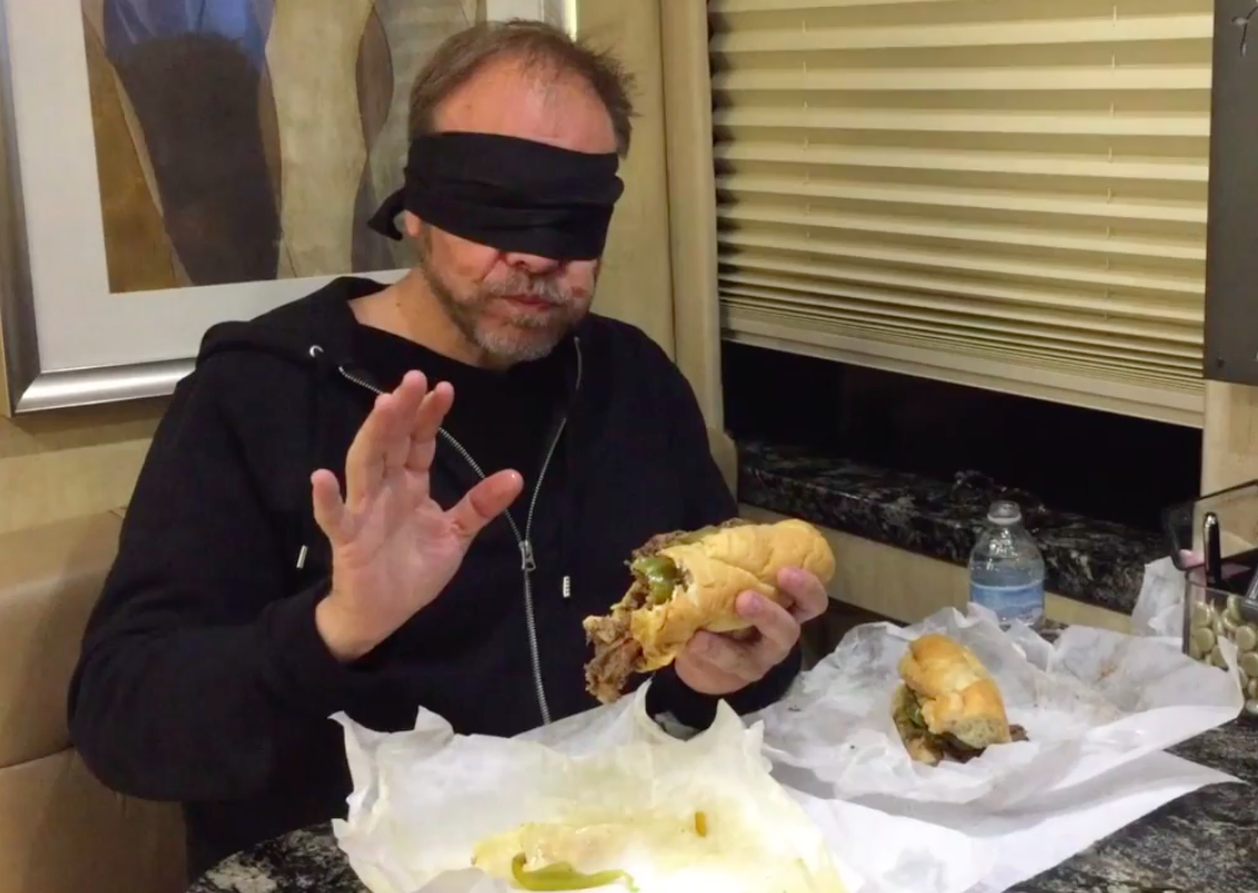 Alton Brown eating a Chicago Italian beef
