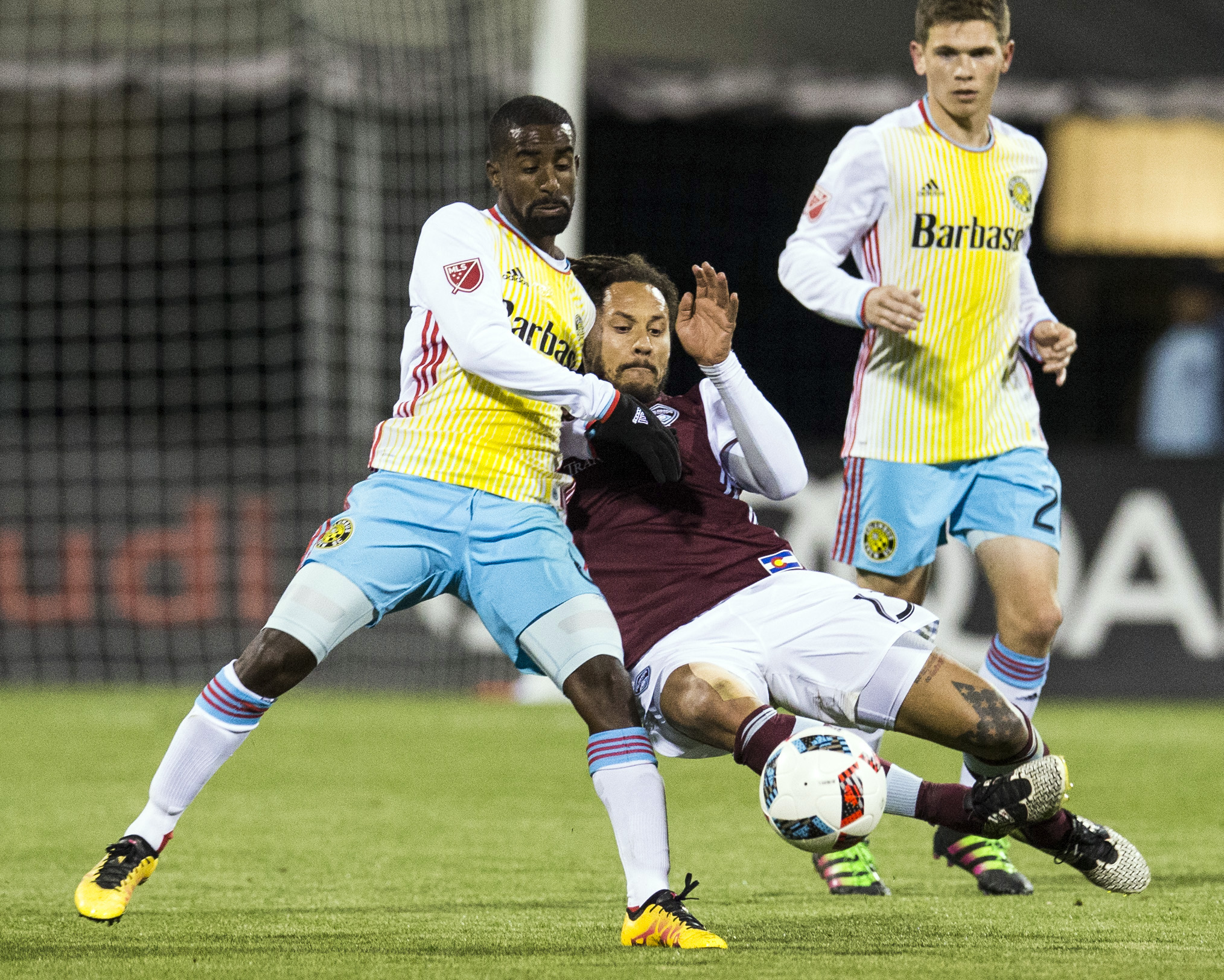 Jermaine Jones going down low to tack the ball away in the Rapids match vs Columbus Crew SC.