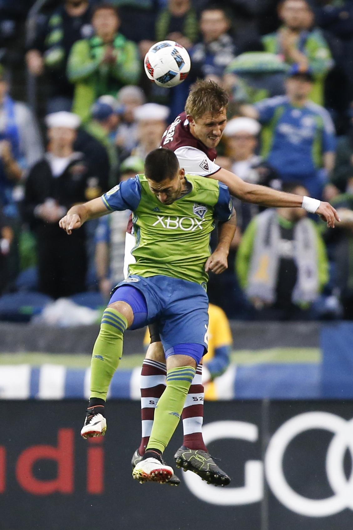 Axel Sjoberg challenges Clint Dempsey for the ball.