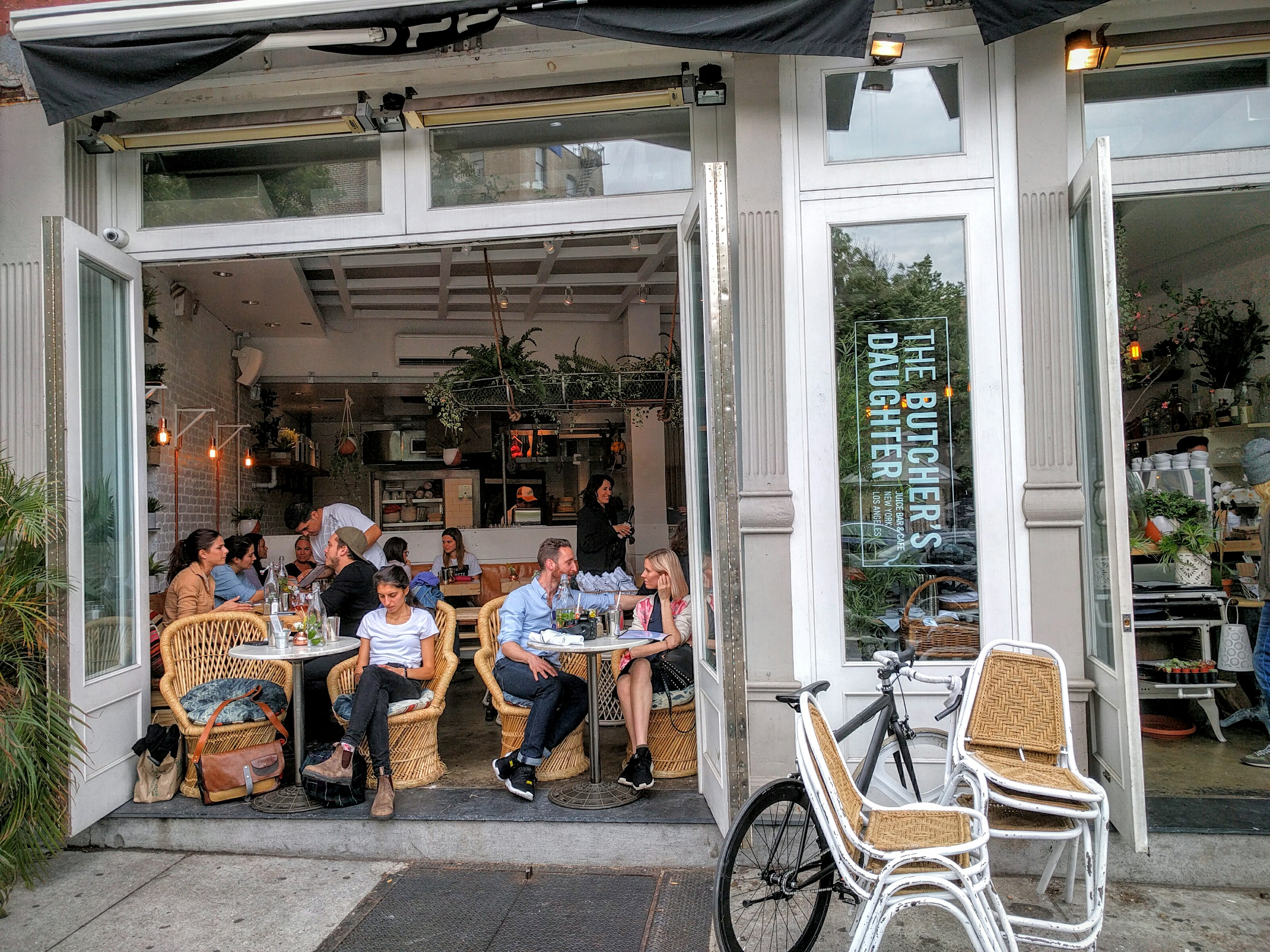 [The West Village location of The Butcher's Daughter, in full swing]