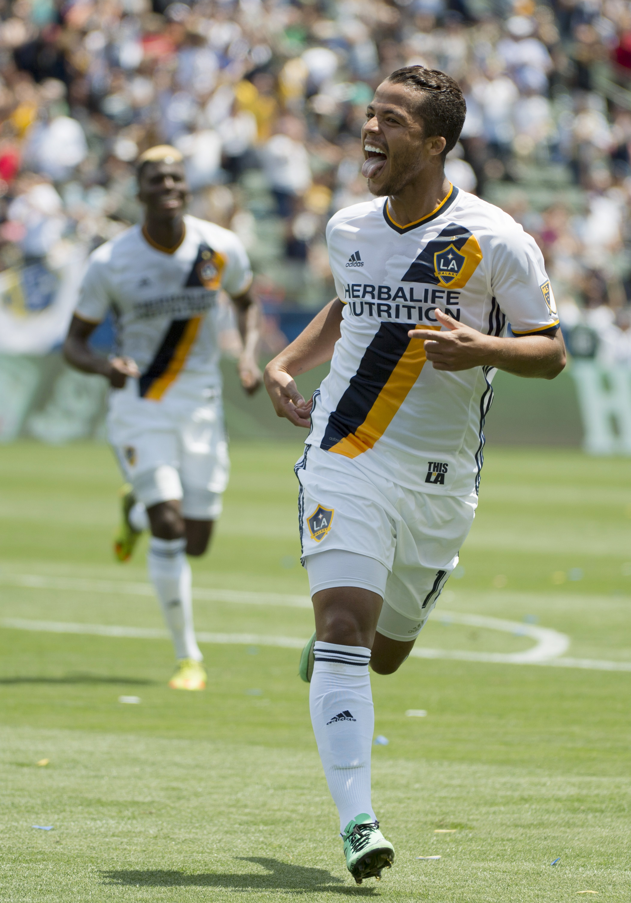 Gio dos Santos celebrates his goal against the New England Revolution.