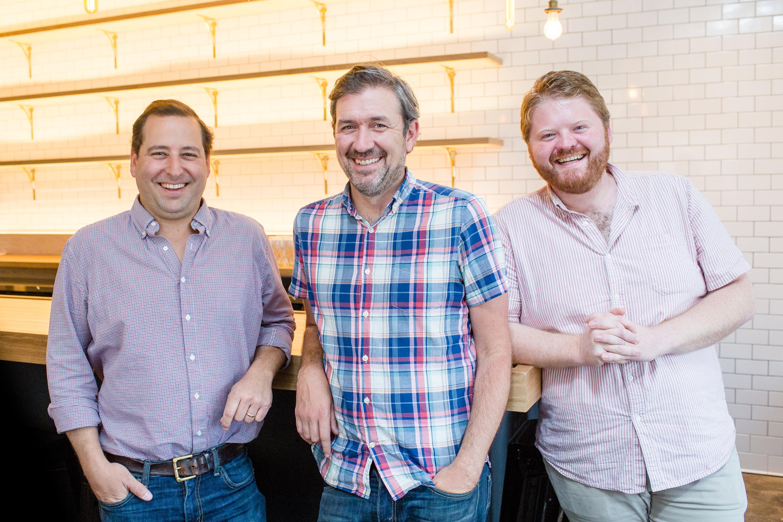 Neal Bodenheimer, Kirk Estopinal and Nick Detrich inside Cafe Henri.