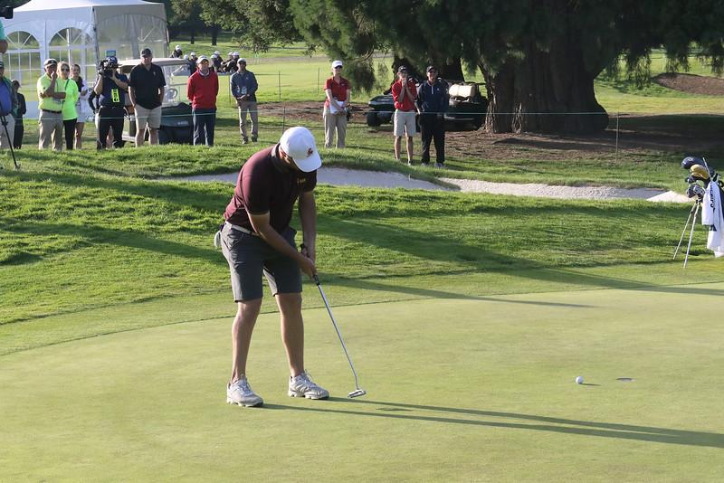 Arizona State's Jon Rahm putting out on his final hole Monday.
