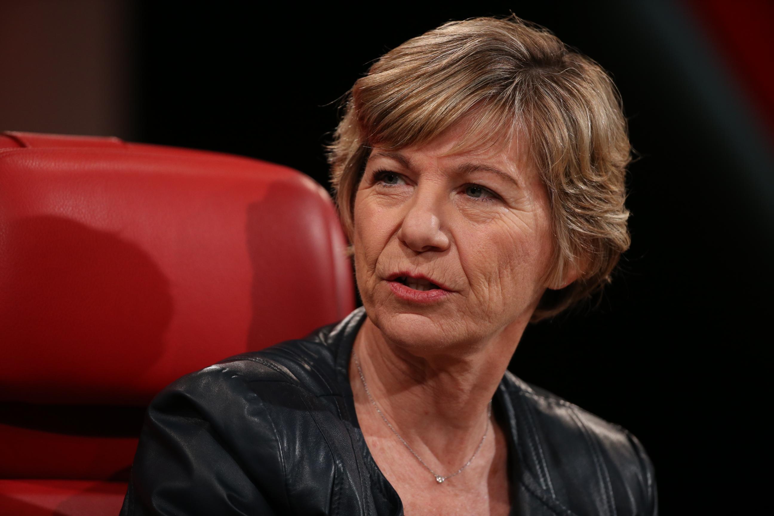 Sue Desmond-Hellmann onstage in a red chair.