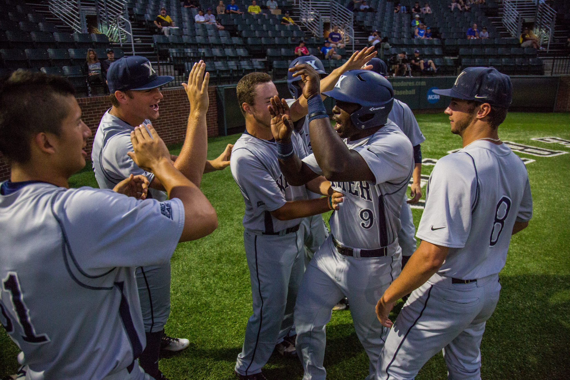 Andre Jernigan and friends celebrate his first-inning homer.