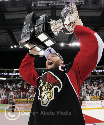 BSens' Captain Ryan Keller celebrates with the Calder Cup in Houston, Texas