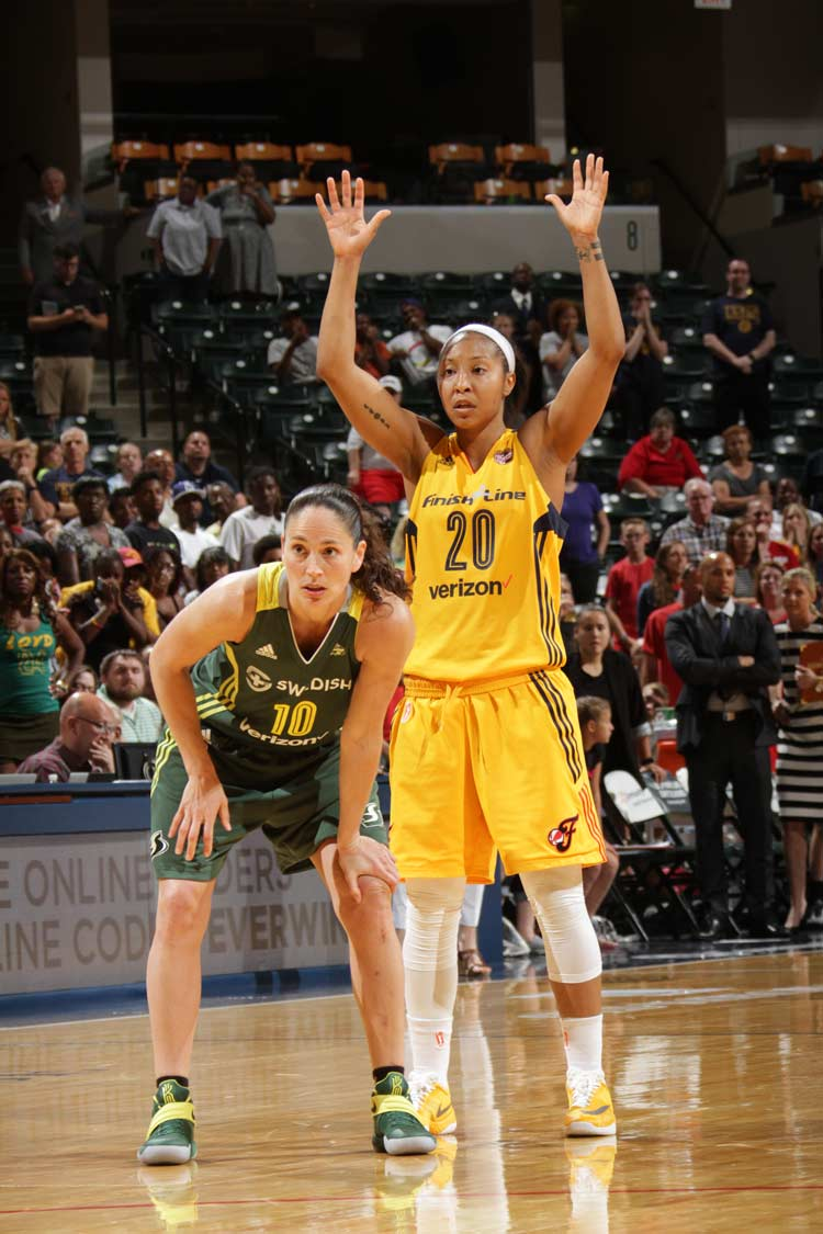 Sue Bird and Briann January battle down the stretch
