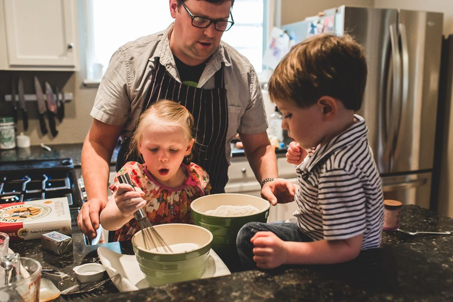 Chef Paul Reilly cooking with his two older children