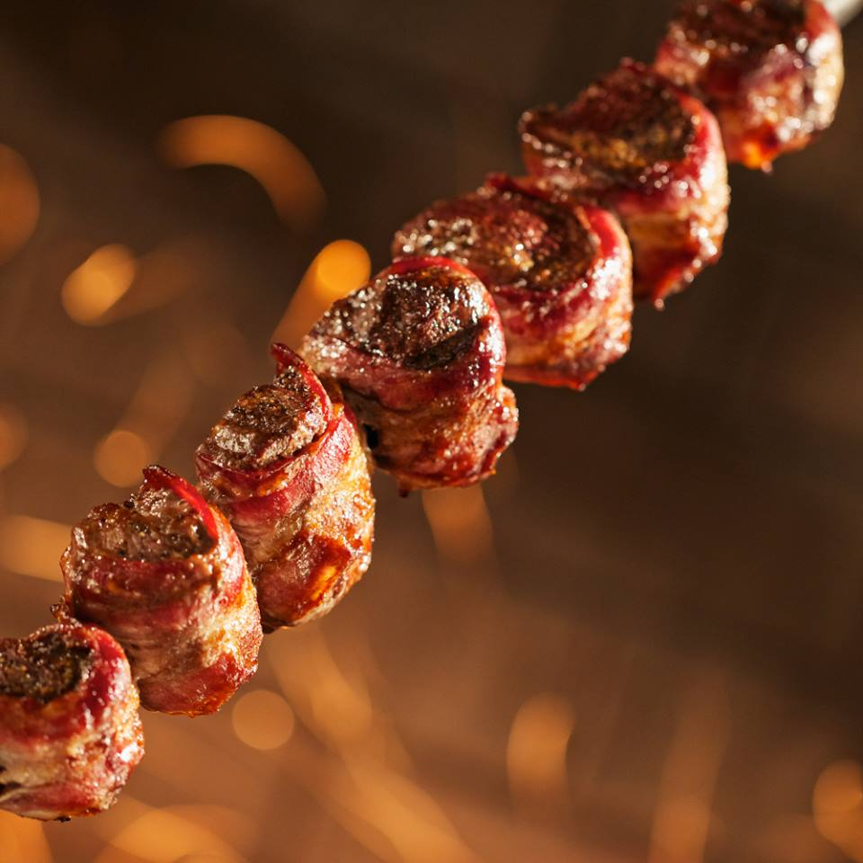 Meat wrapped in bacon at Fogo de Chão
